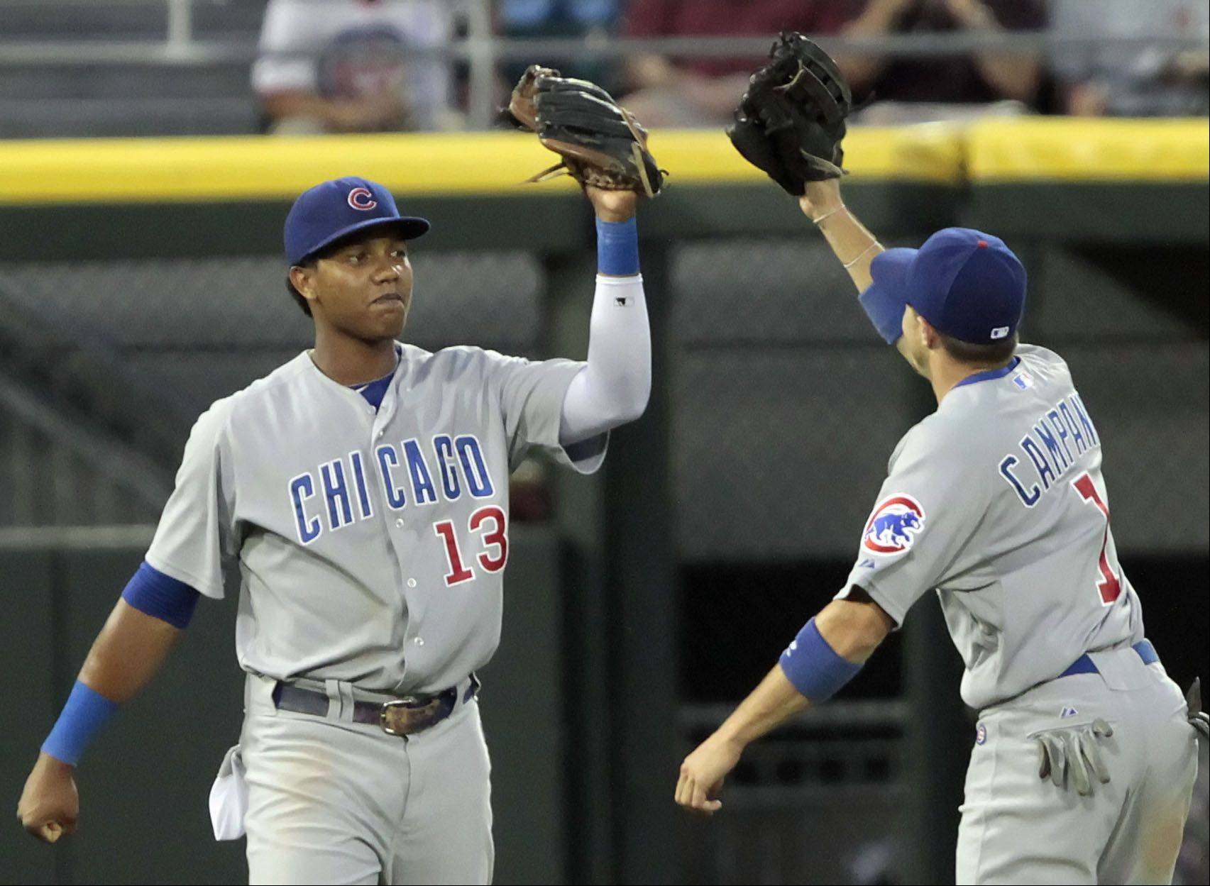 Chicago Cubs' Starlin Castro get a high five from Chicago Cubs' Tony Campana after Castro made a barehand catch.