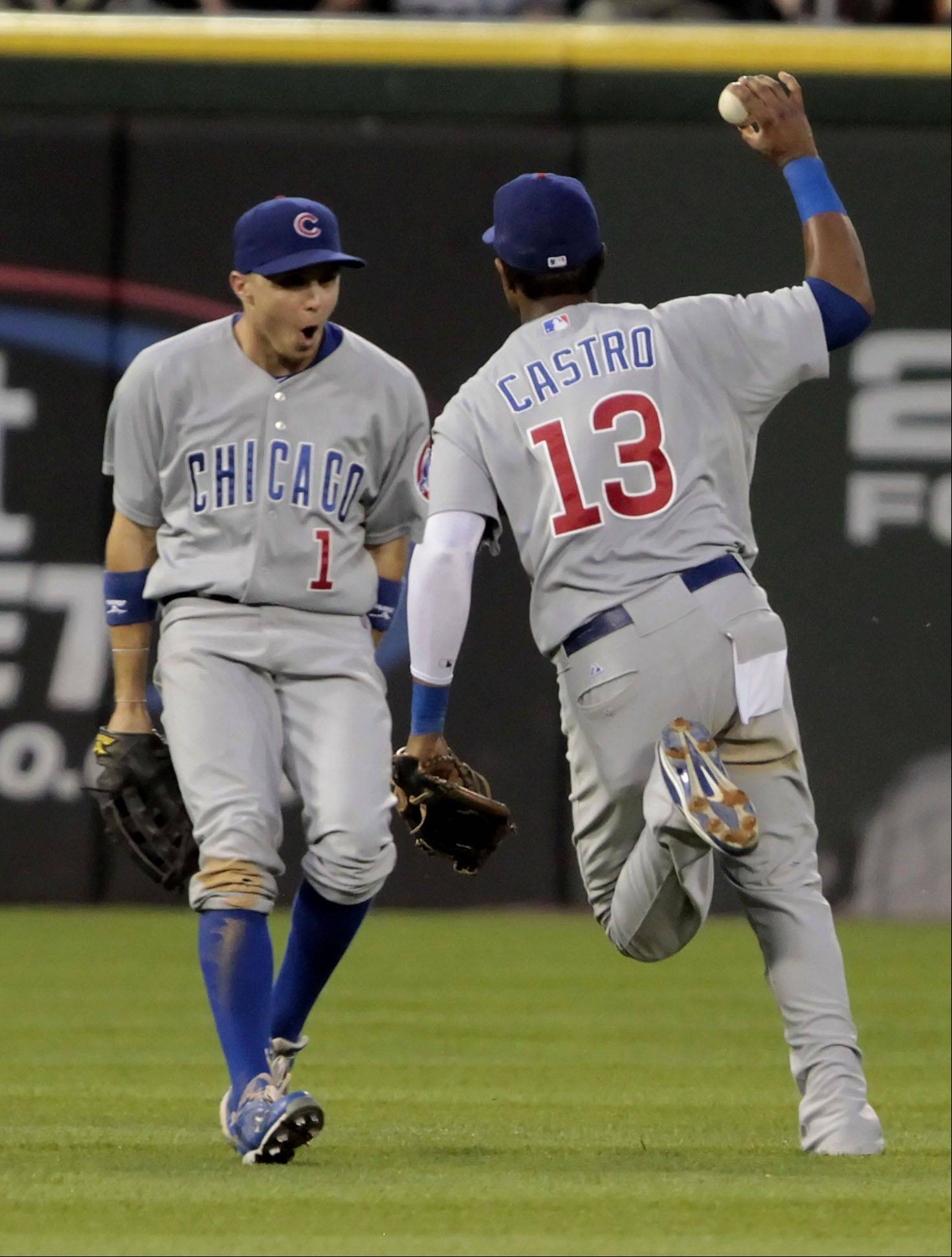 Chicago Cubs' Tony Campana, left, reacts after Starlin Castro made a barehand grab in the fifth inning .