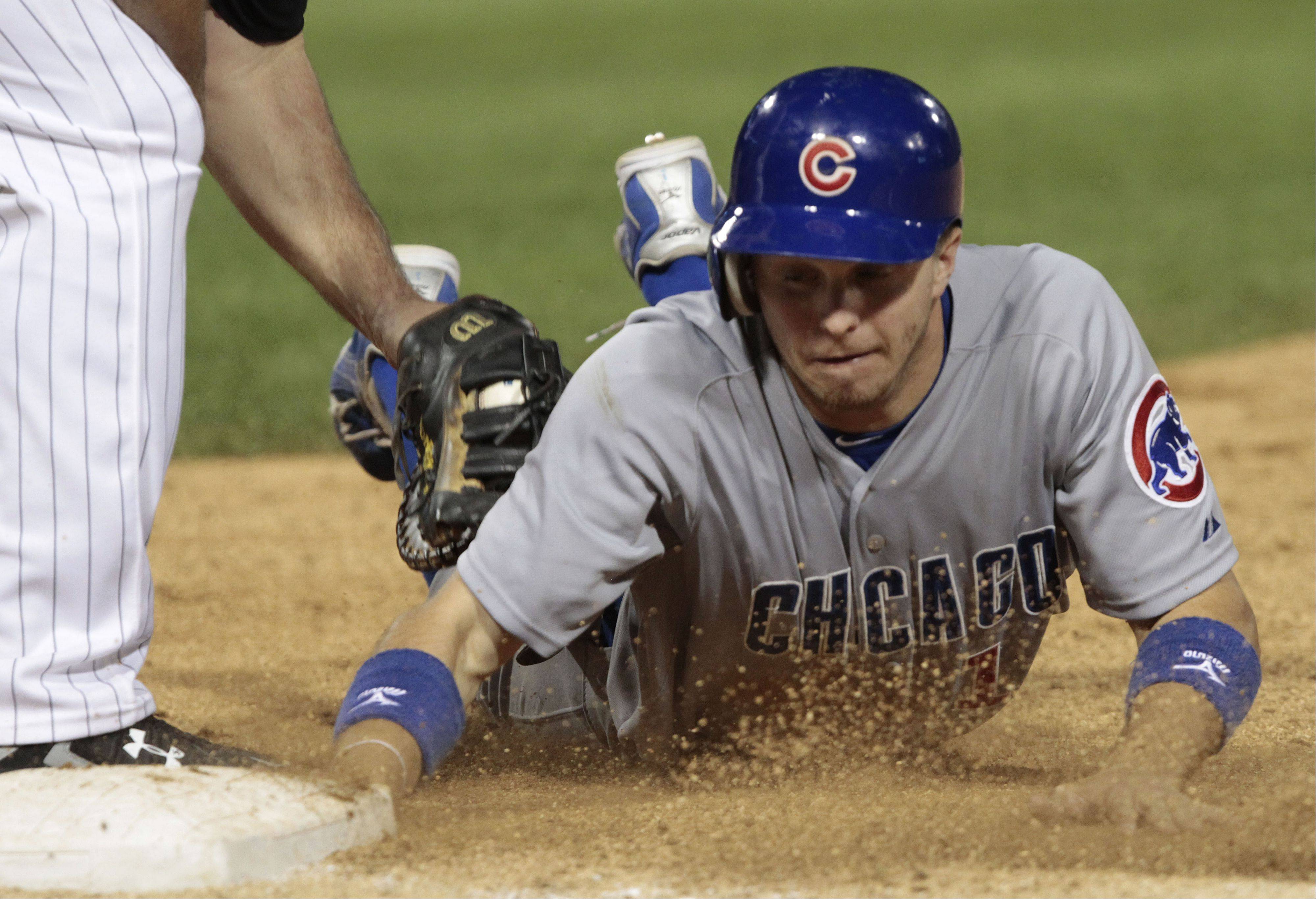 Chicago Cubs' Tony Campana is tagged out at first by Chicago White Sox's Paul Konerko.