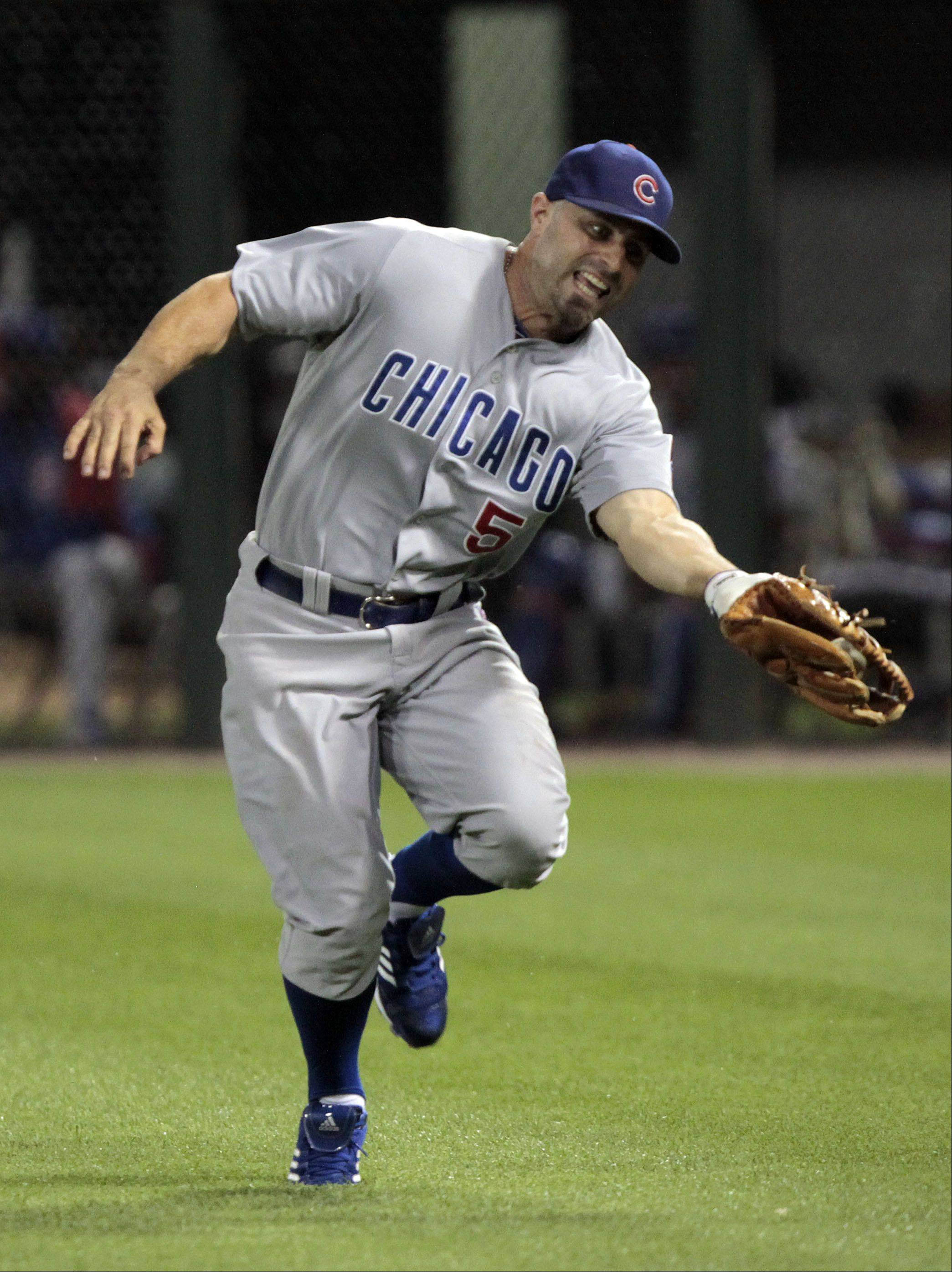 Chicago Cubs' Reed Johnson makes a running catch in the eighth inning.