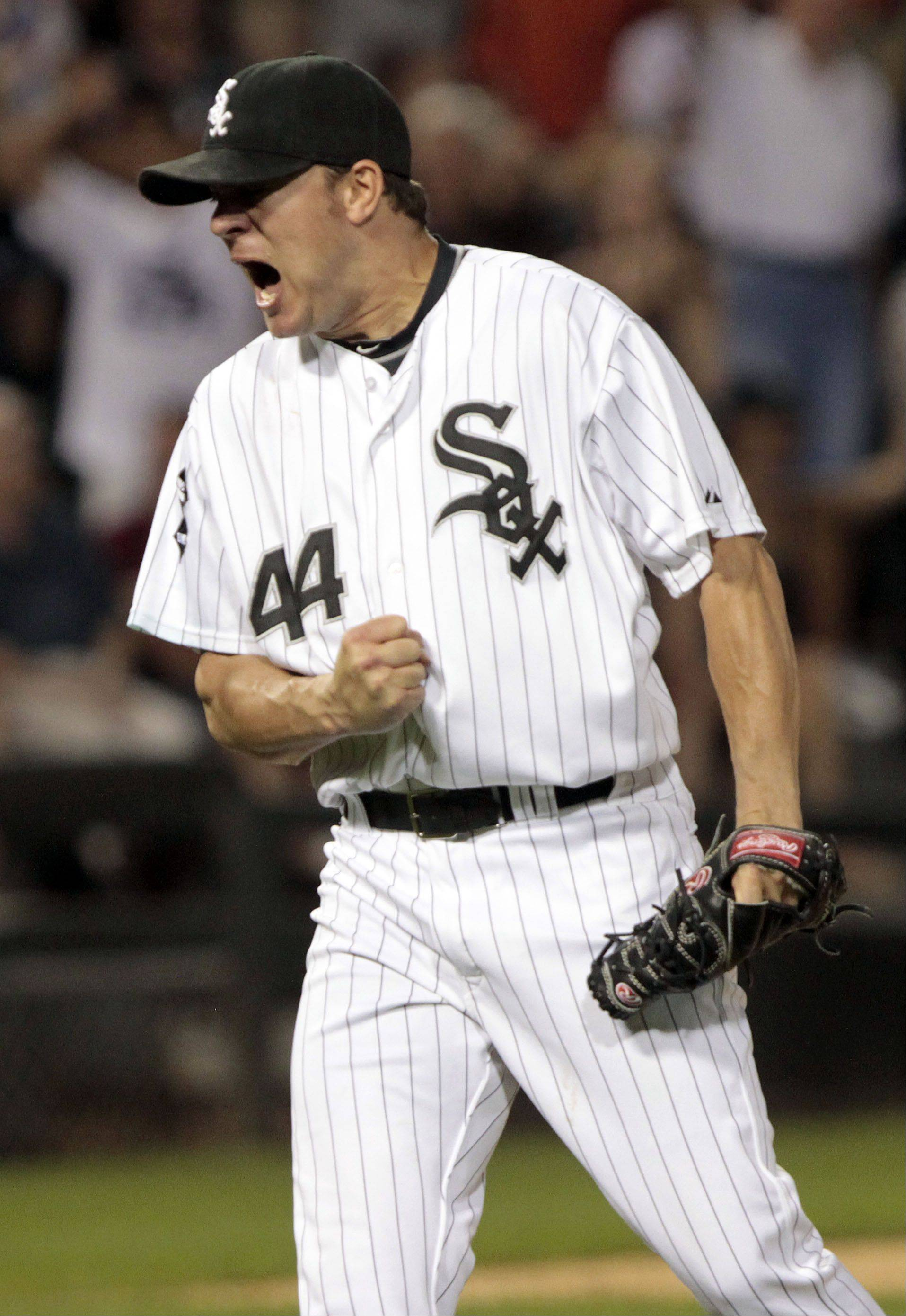Chicago White Sox's Jake Peavy celebrates late in the game.