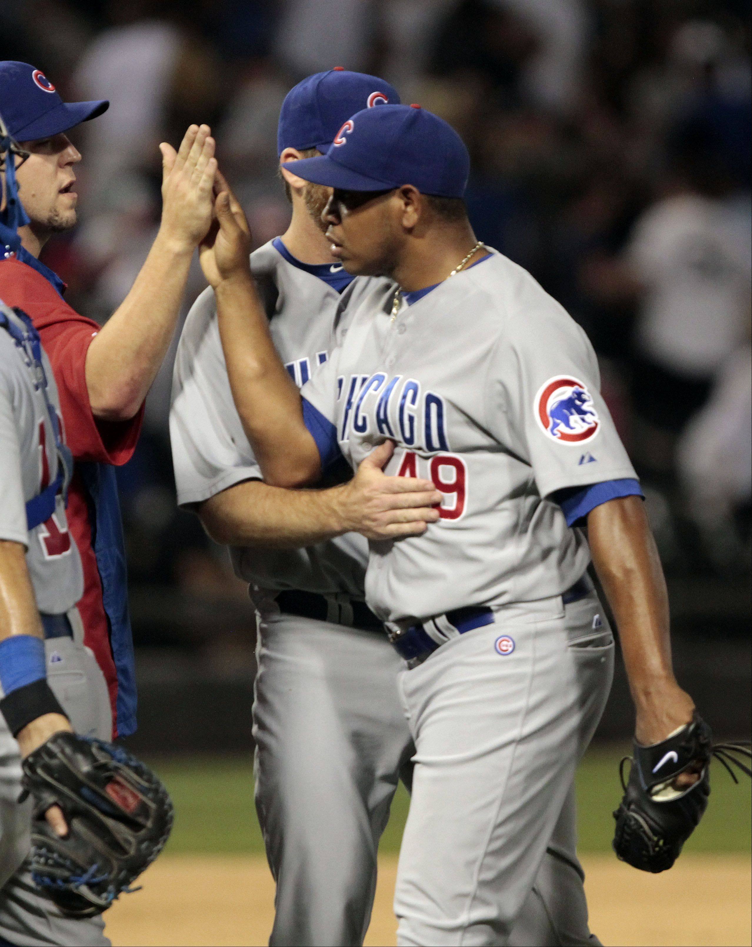 Chicago Cubs' Carlos Marmol celebrates after getting the save.