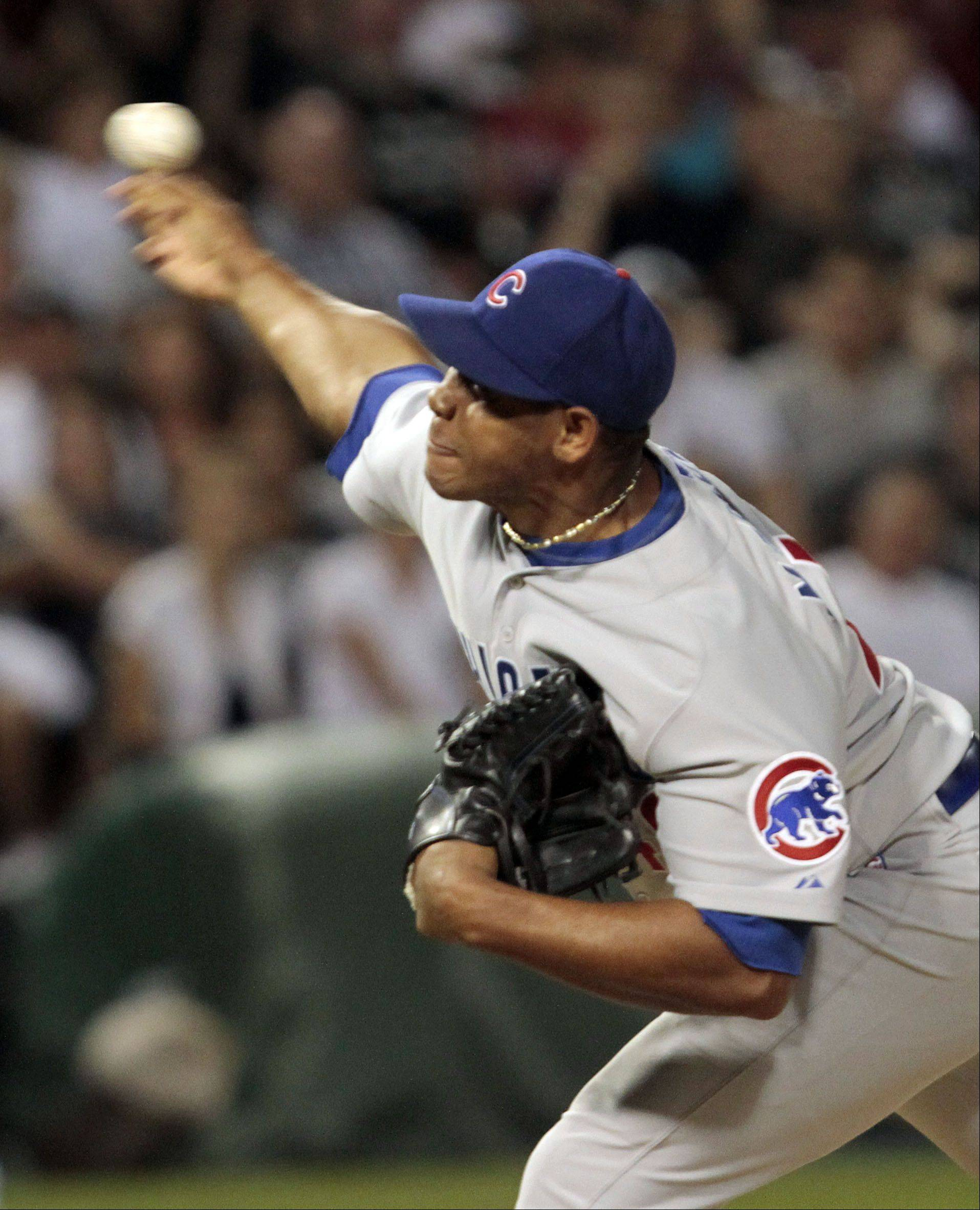 Chicago Cubs' Carlos Marmol delivers.