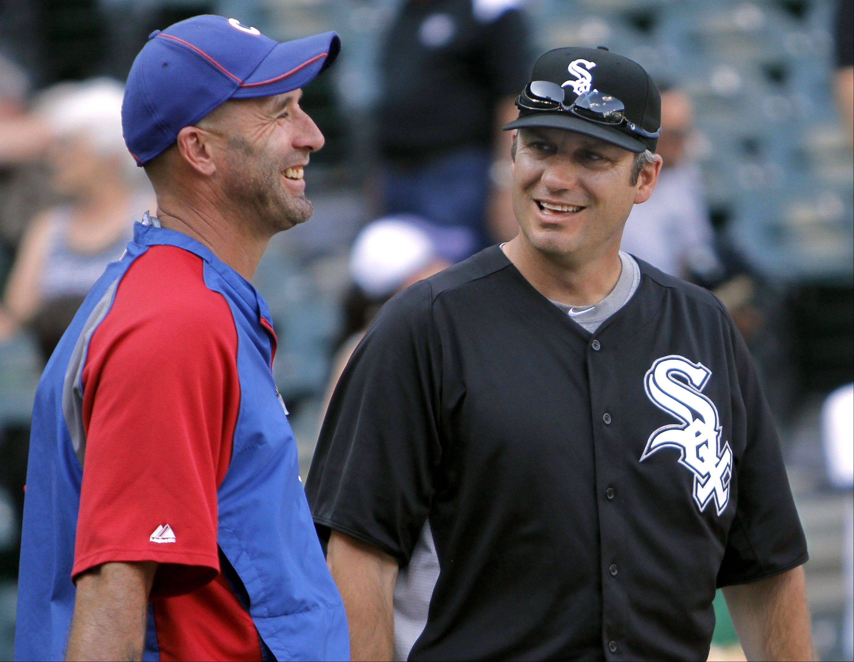 Chicago Cubs manager Dale Sveum, left, and Chicago White Sox manager Robin Ventura chat before the game.