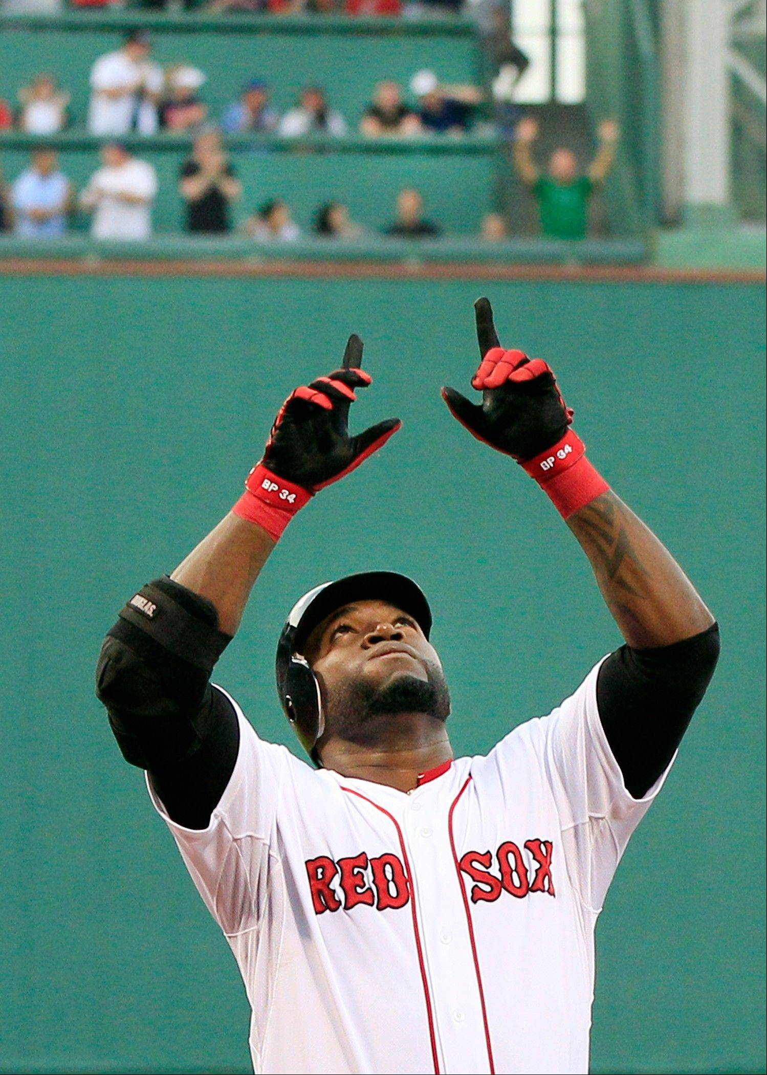Boston Red Sox designated hitter David Ortiz gestures as he crosses the plate Tuesday after hitting a two-run homer against the Miami Marlins in the first inning at Fenway Park in Boston.