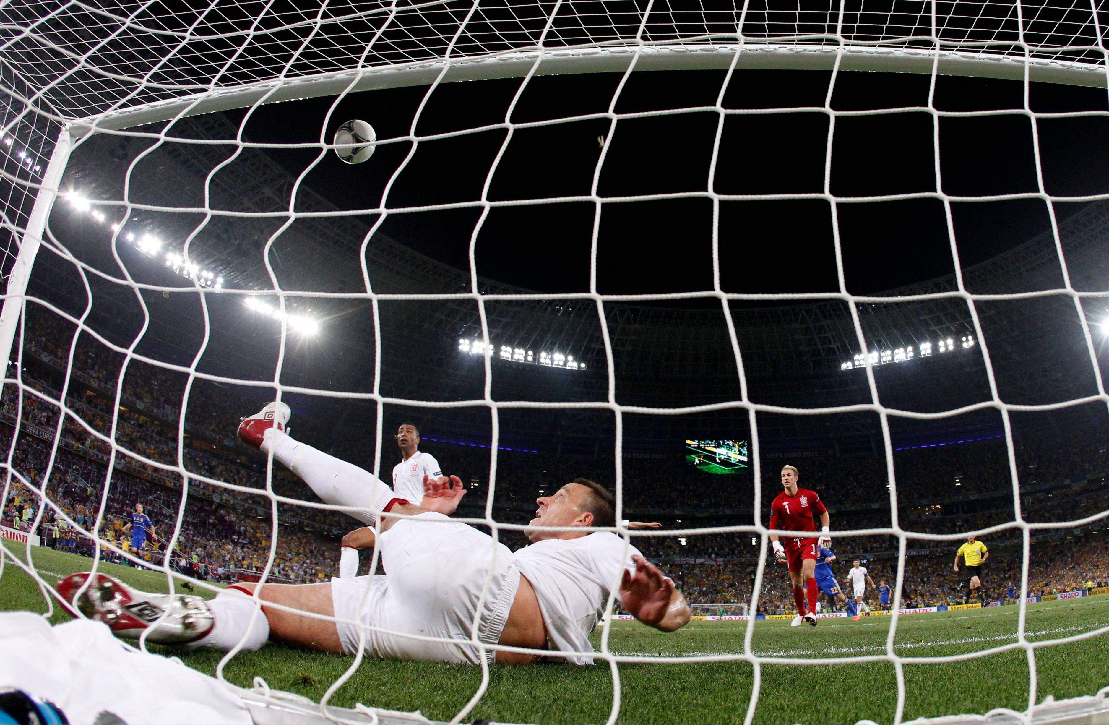 England's John Terry clears the ball away from his goal Tuesday during the Euro 2012 soccer match between England and Ukraine in Donetsk, Ukraine.