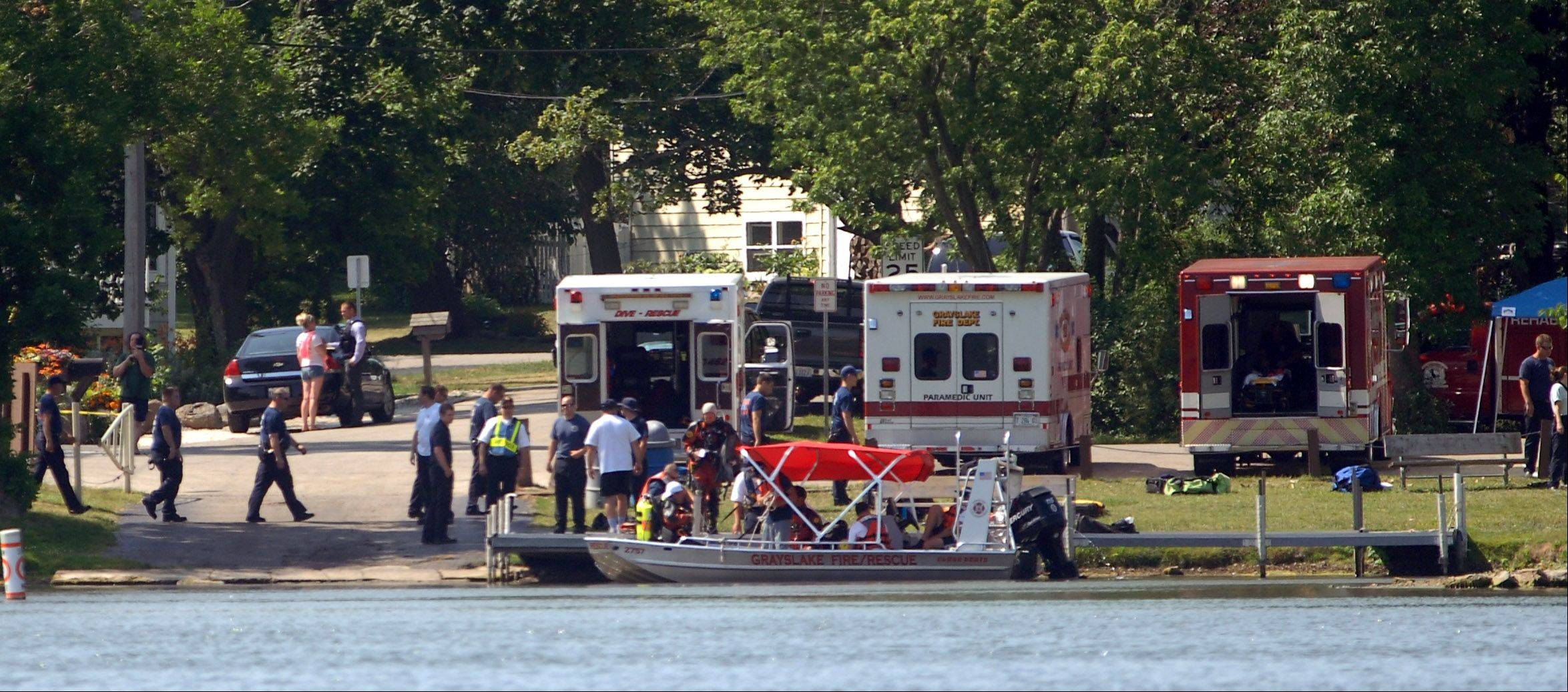 Rescue crews set up along Sears Boulevard near Grayslake Tuesday morning to search for a missing swimmer on Gages Lake.
