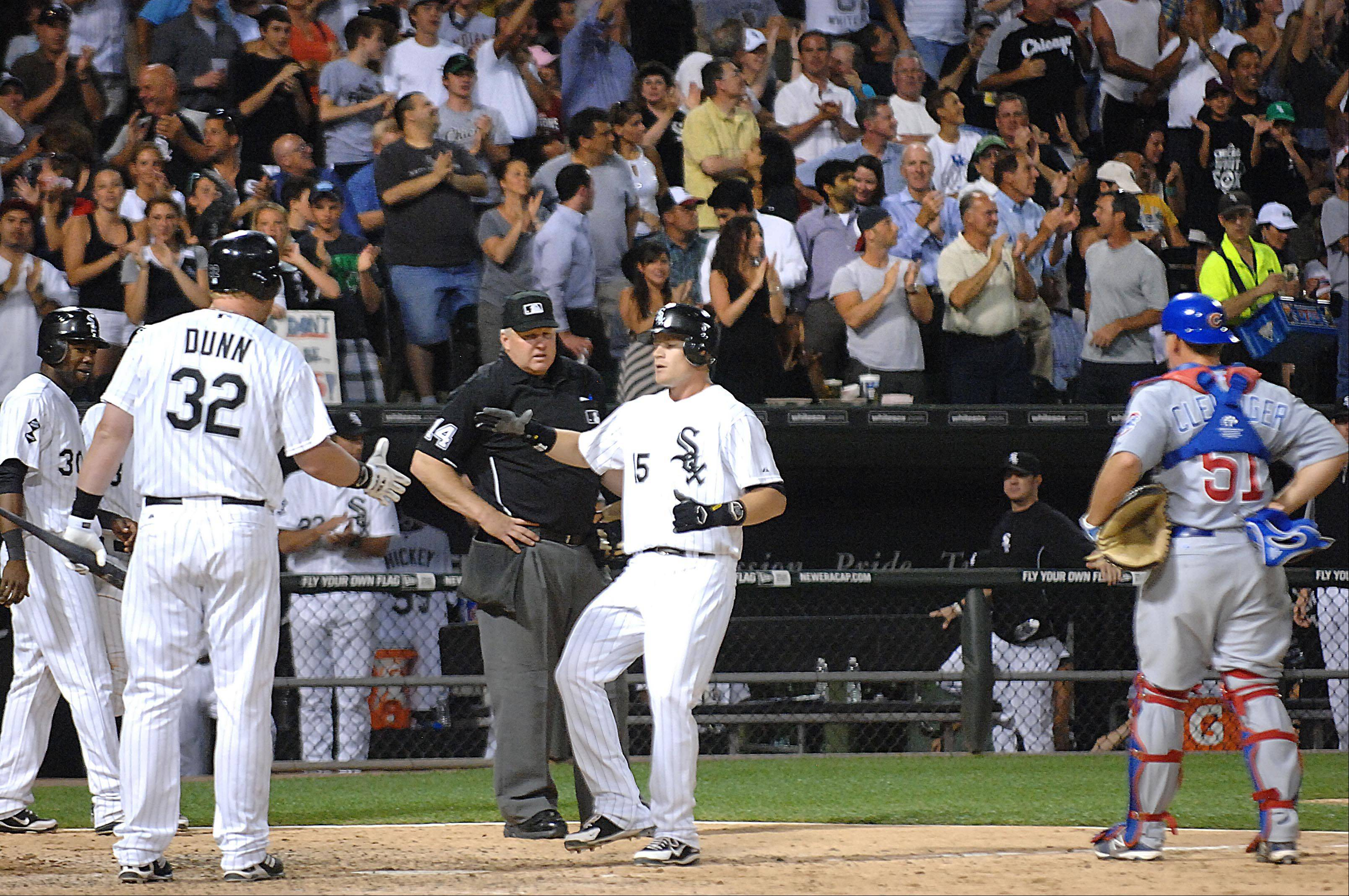 Chicago White Sox second baseman Gordon Beckham is greeted at home plate after his three-run home run in the sixth inning.