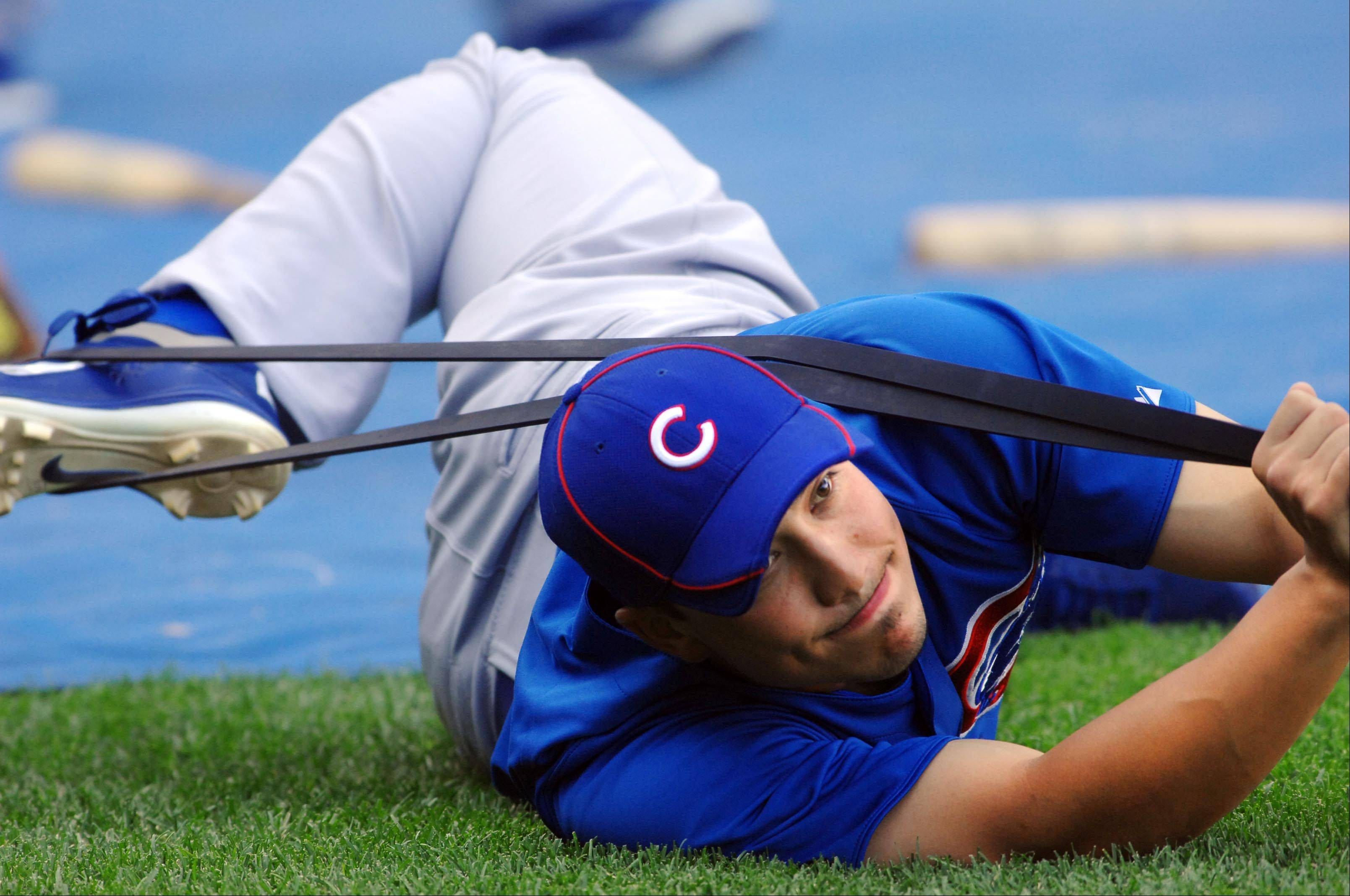 Chicago Cubs second baseman Darwin Barney stretches before the game.