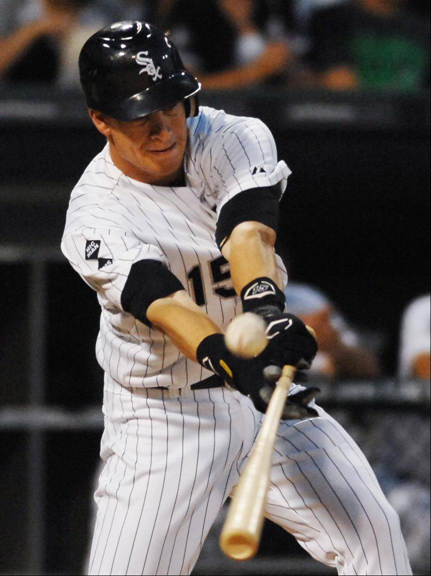 Chicago White Sox second baseman Gordon Beckham hits a pop up to shallow right field to score Alexi Ramirez from second base in the fourth inning.