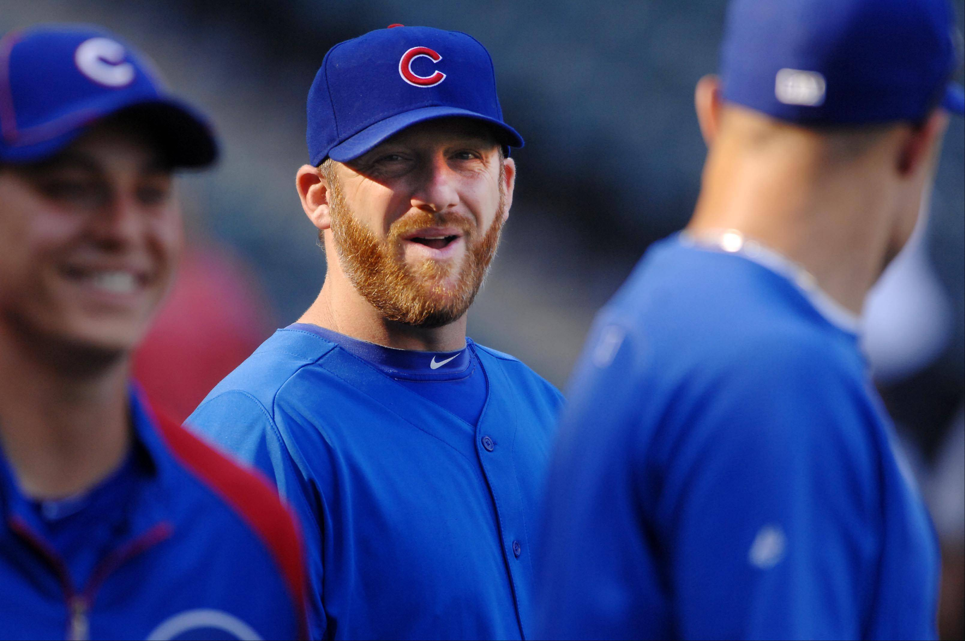 Chicago Cubs pitcher Ryan Dempster laughs with teammates before the game.