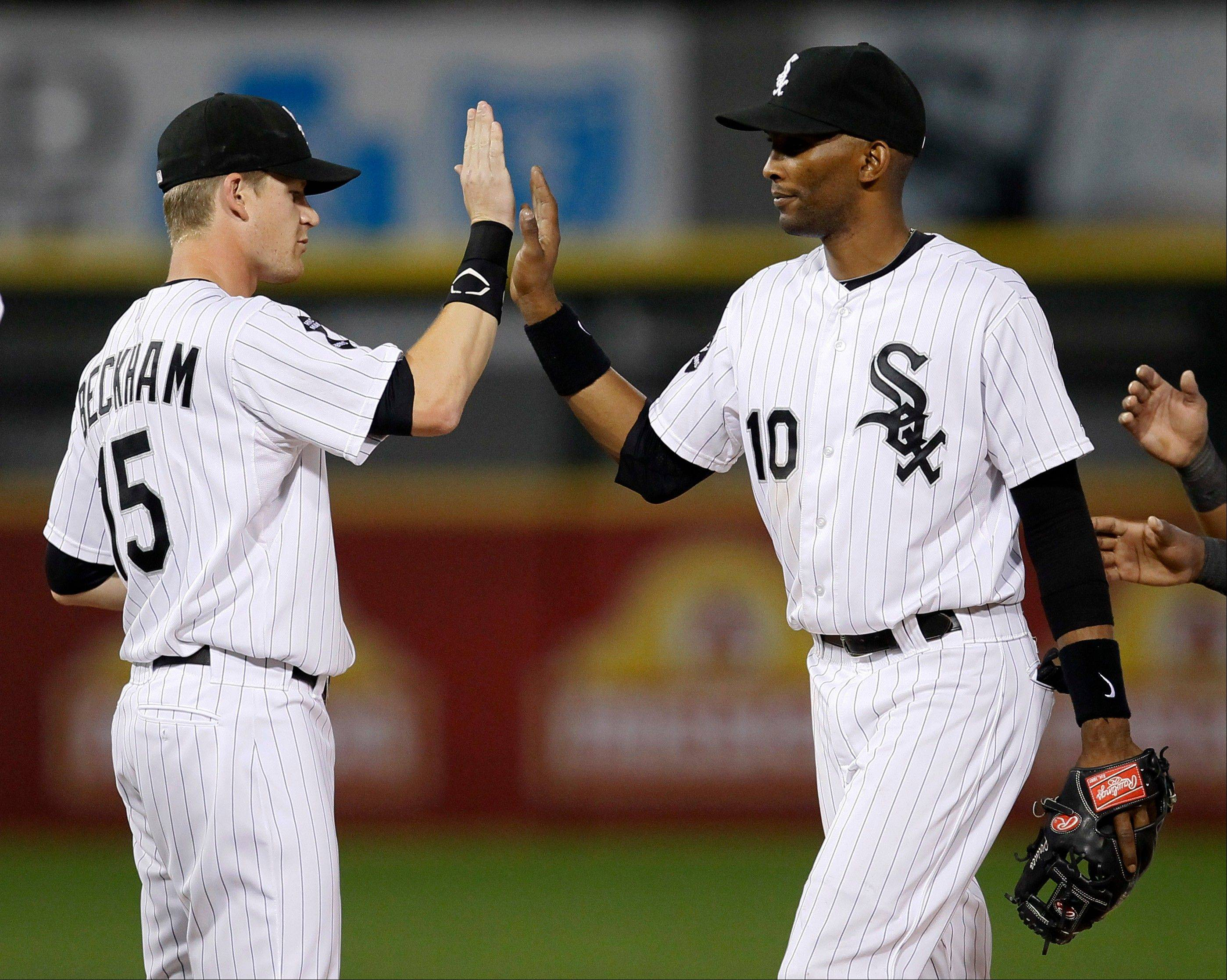 Chicago White Sox second baseman Gordon Beckham, left, and shortstop Alexei Ramirez celebrate their 7-0 win over the Chicago Cubs.