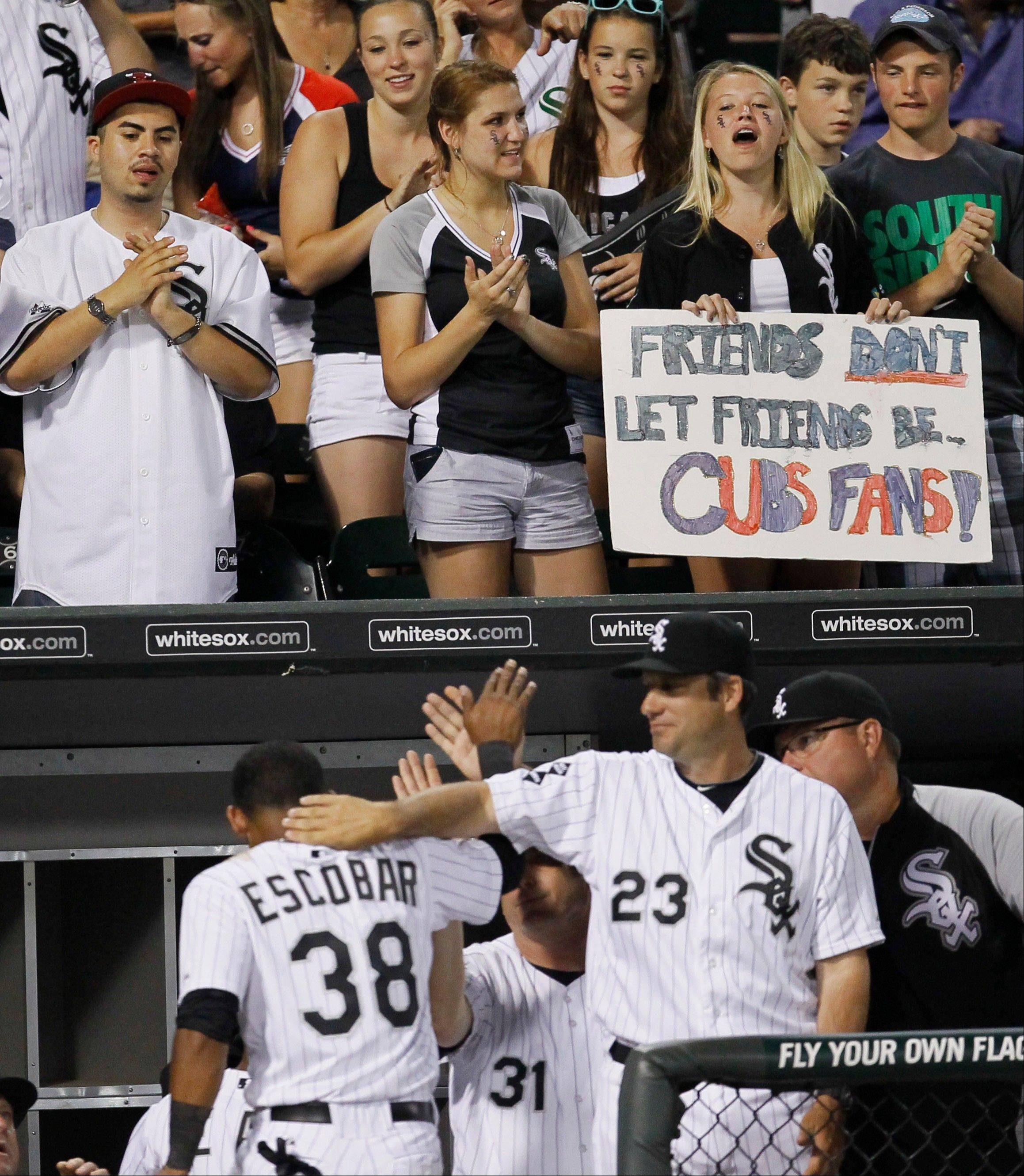 Chicago White Sox fans, top, celebrate Gordon Beckham's three-run home run , which scored Alejandro De Aza and Eduardo Escobar during the sixth inning.