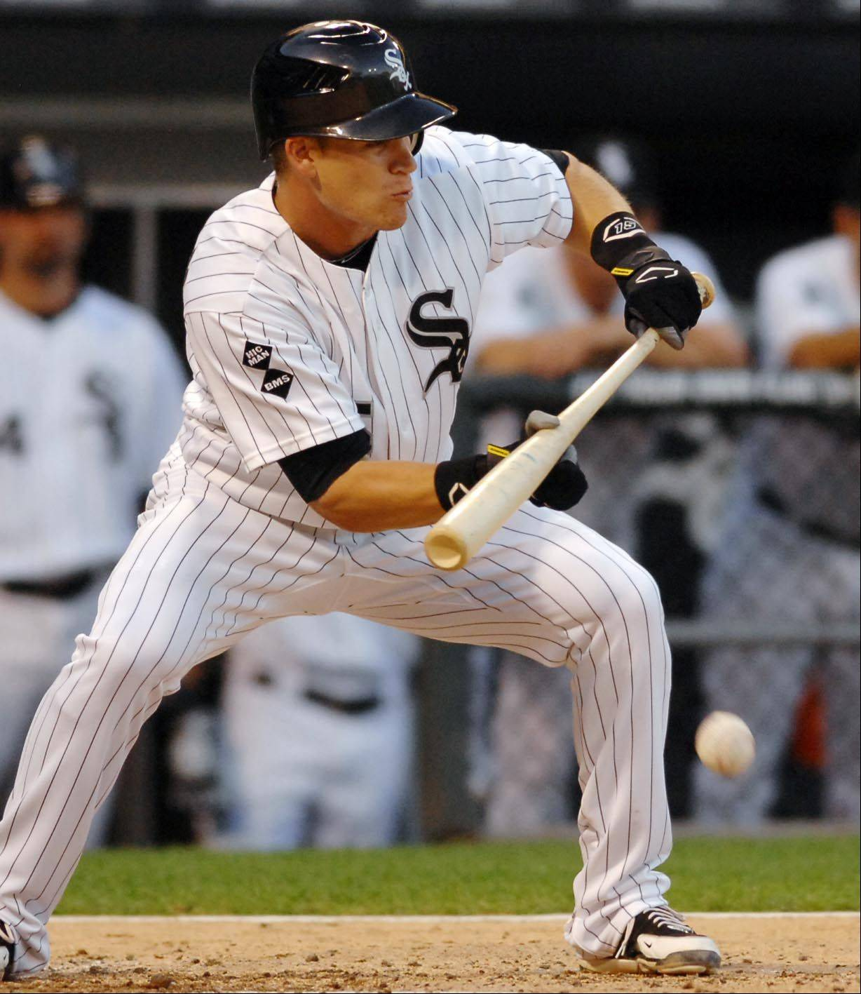 Chicago White Sox second baseman Gordon Beckham lays down a sacrifice bunt in the third inning.