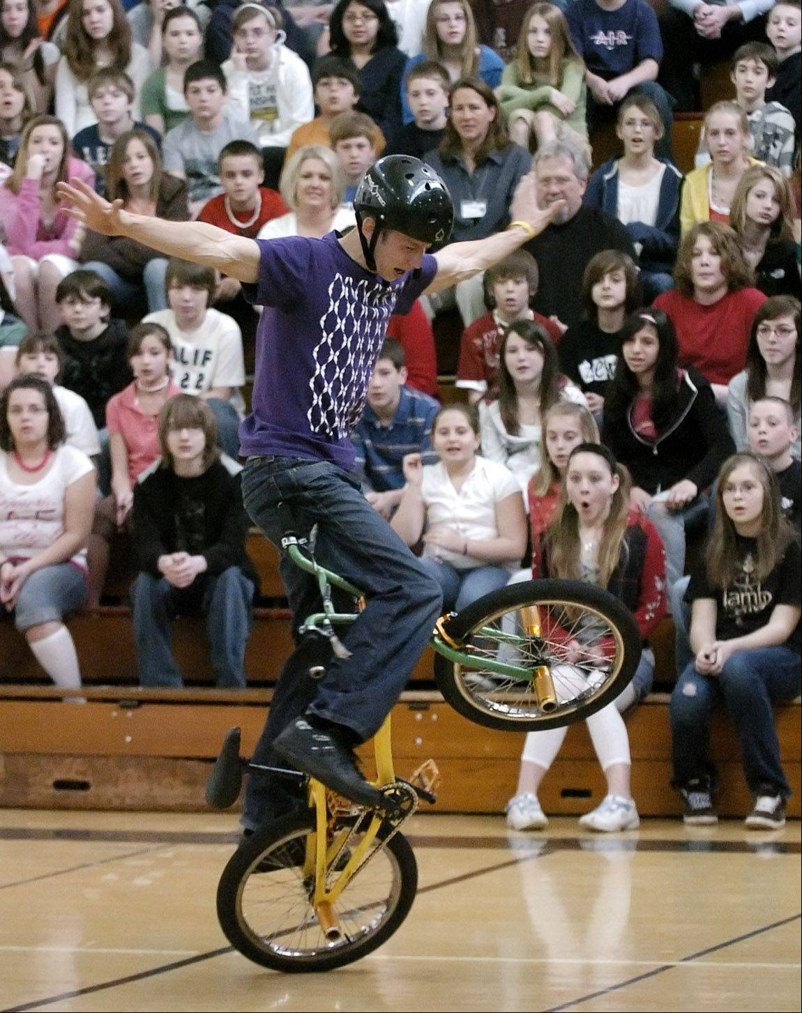 Matt Wilhelm performs for kids at Thompson Middle School in St. Charles.