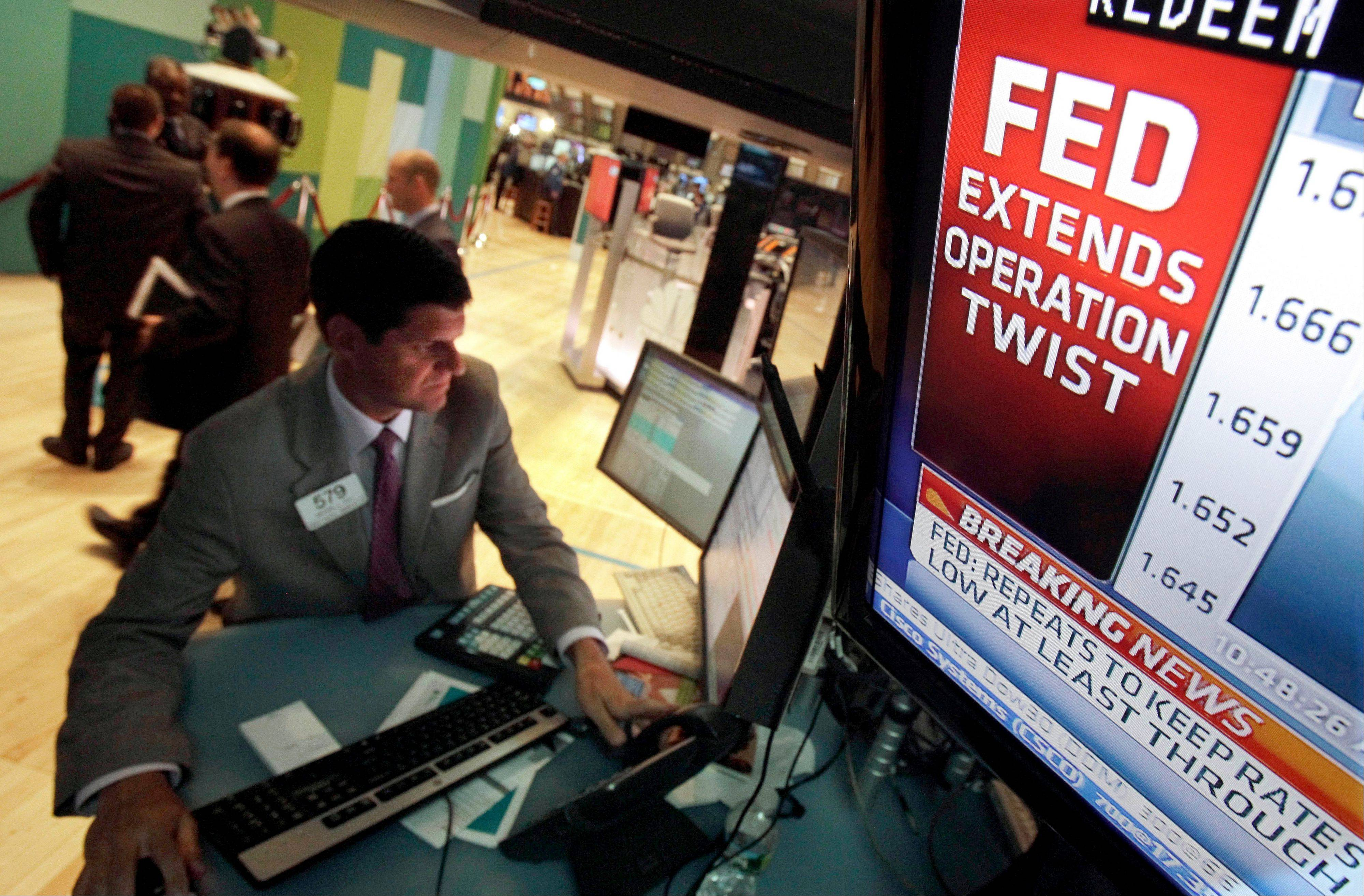 The decision of the Federal Reserve is visible on a television monitor at the trading post of specialist Michael Guli, on the floor of the New York Stock Exchange Wednesday.