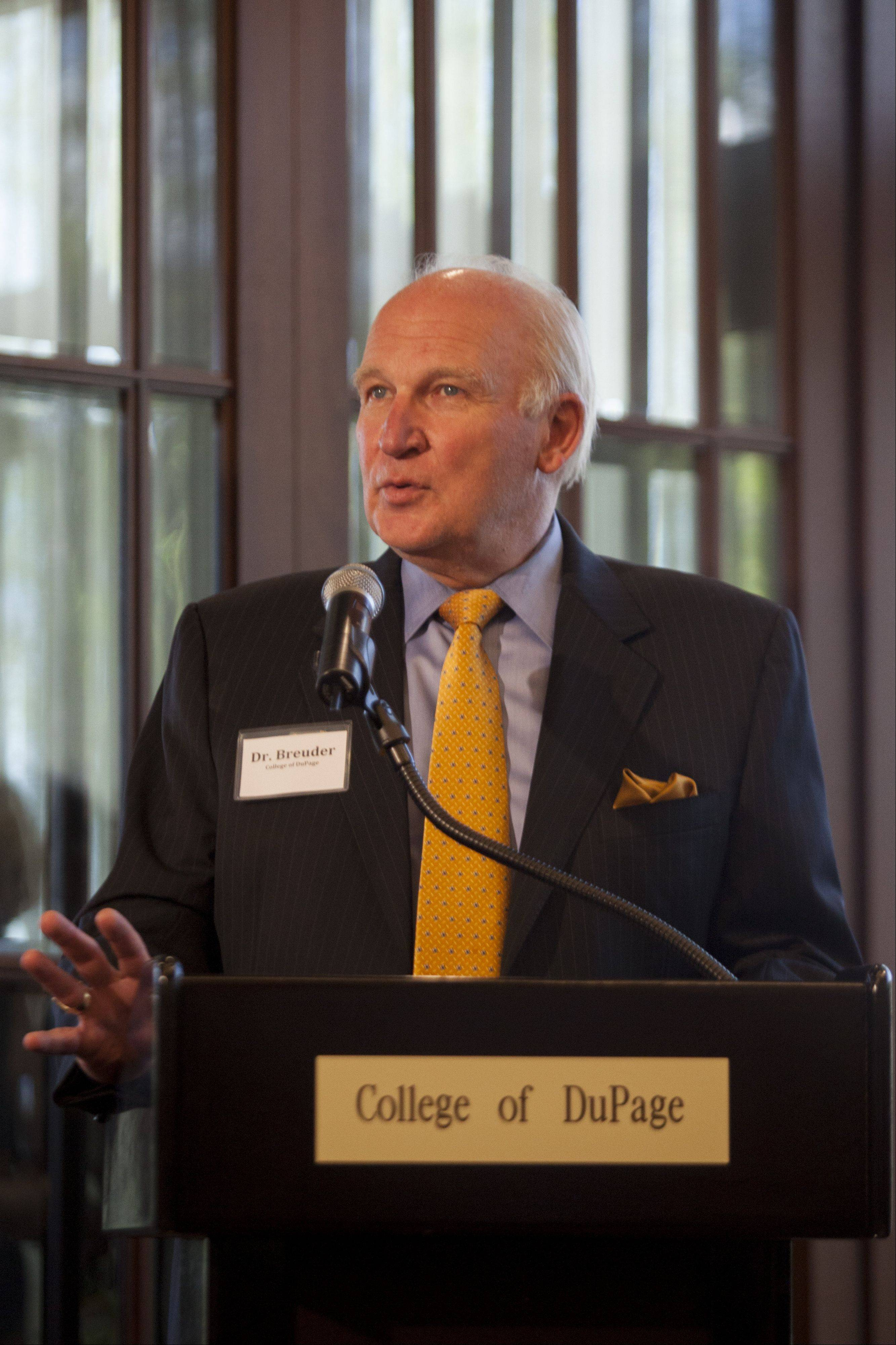 Dr. Robert L. Breuder President of College of DuPage speaks during the Celebration of Cleve Carney Thursday.
