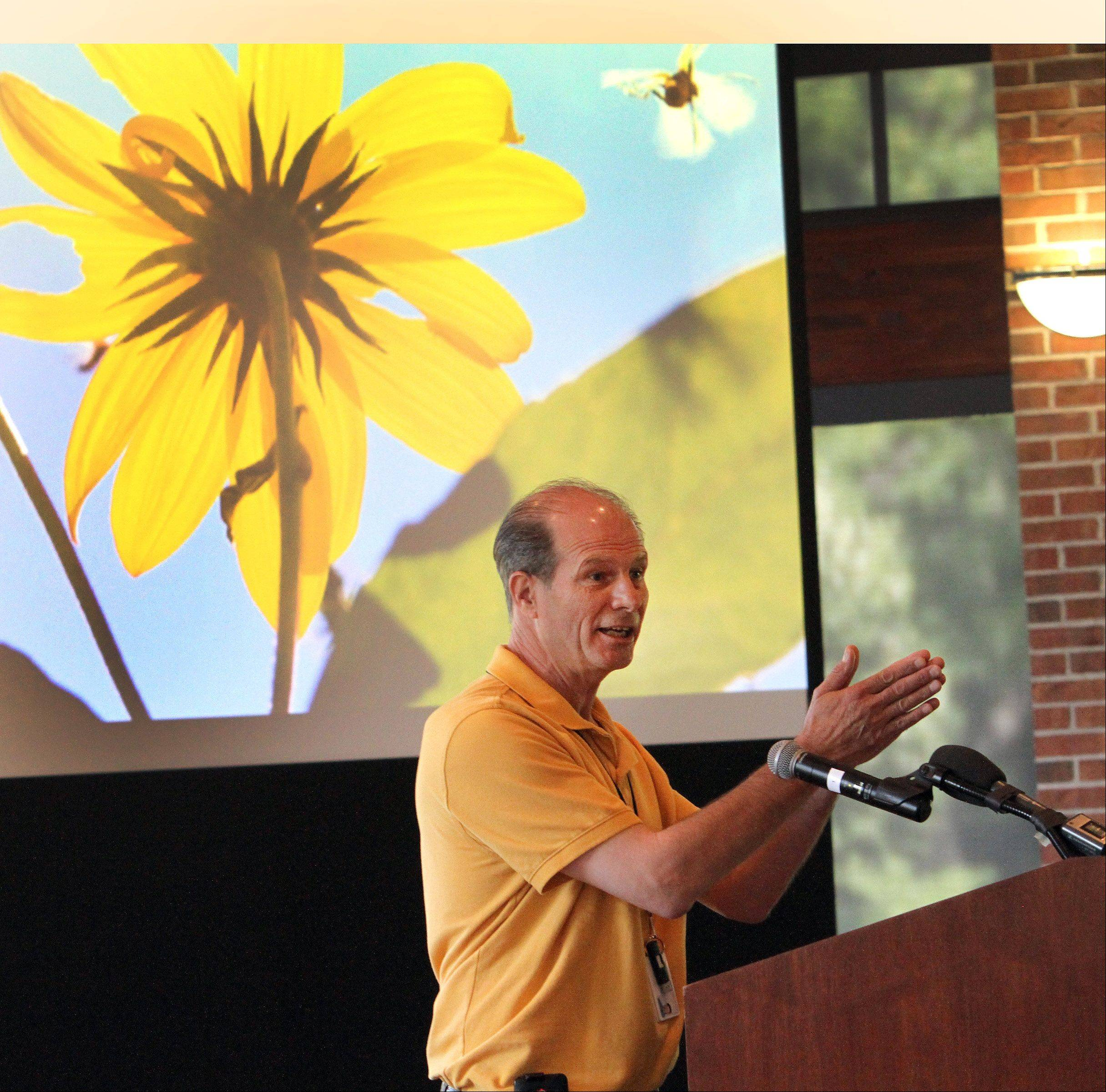 Daily Herald photographer George LeClaire speaks about shooting the environment during a Daily Herald Subscriber Total Access photo workshop Thursday at Cantigny Park in Wheaton. The event drew nearly 100 participants.