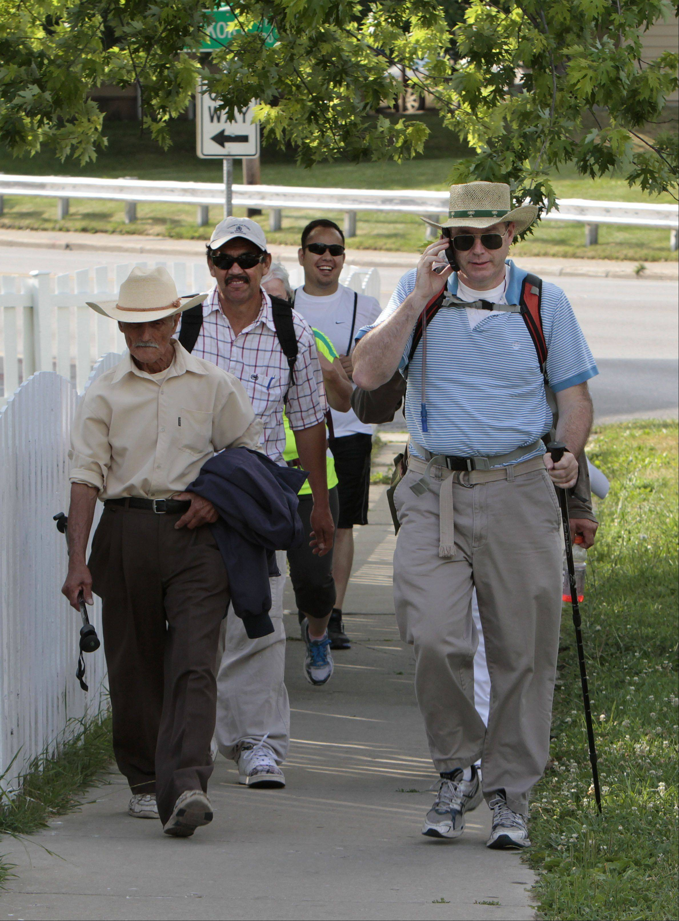 Rev. Timothy O'Malley, pastor of St. Joseph Parish in Round Lake, and about 12 companions start a 168-mile pilgrimage from Immaculate Conception Church in Waukegan to Our Lady of Good Help Shrine in Champion, Wis. They plan to arrive at the shrine on June 27 and average 25 to 30 miles per day.