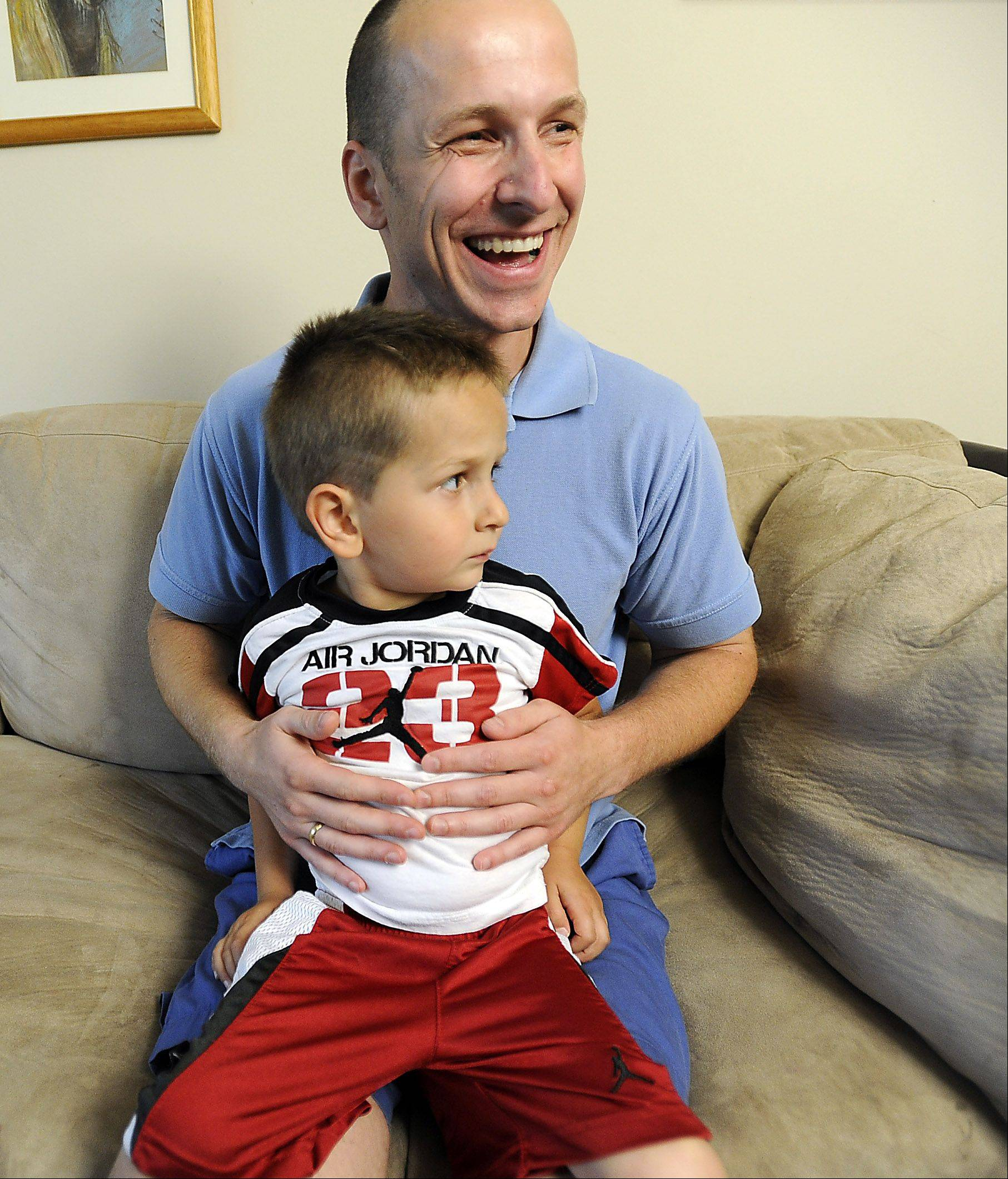"Kalin Koychev, 33, with his son Konstantin, 3, in their home in Wheeling one week before he will undergo an operation donating his kidney to Nathan Saavedra, 3, from Carpentersville. ""I don't feel any panic, but the people around me, they're feeling panic,"" said Koychev, who has never met the Saavedra family and has never had surgery. ""I'm at peace. God is with me and he's helping me."""