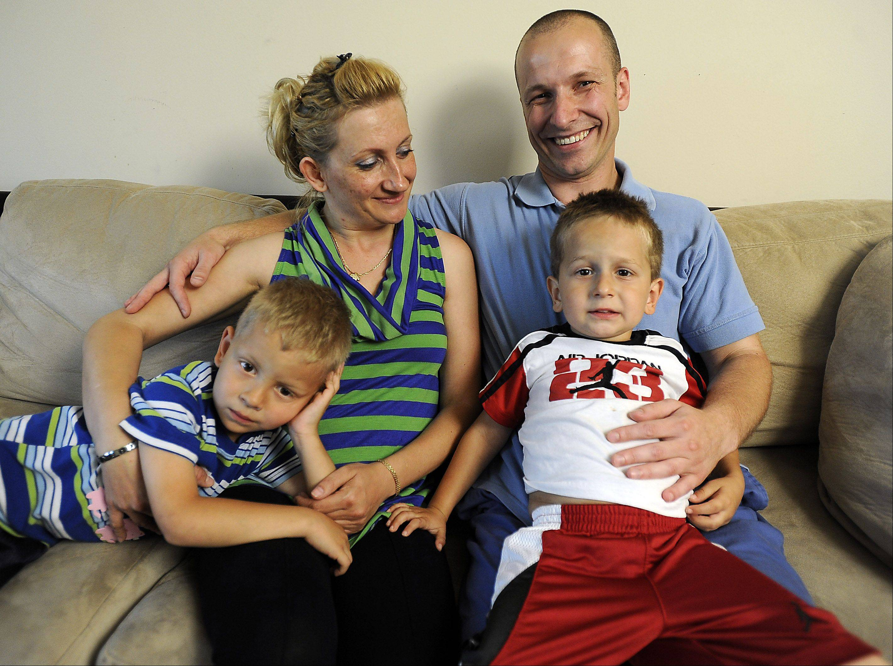 "Kalin Koychev sits with his family -- Sevda Koycheva, his wife of seven years, and sons Kaloyan, 5, left, and Konstantin, 3 -- in their Wheeling home, one week before he will undergo an operation donating his kidney to Nathan Saavedra, 3, of Carpentersville. There was a less than 2 percent chance of Nathan finding a suitable donor. ""Miracles are possible and miracles do happen,"" Koychev said."