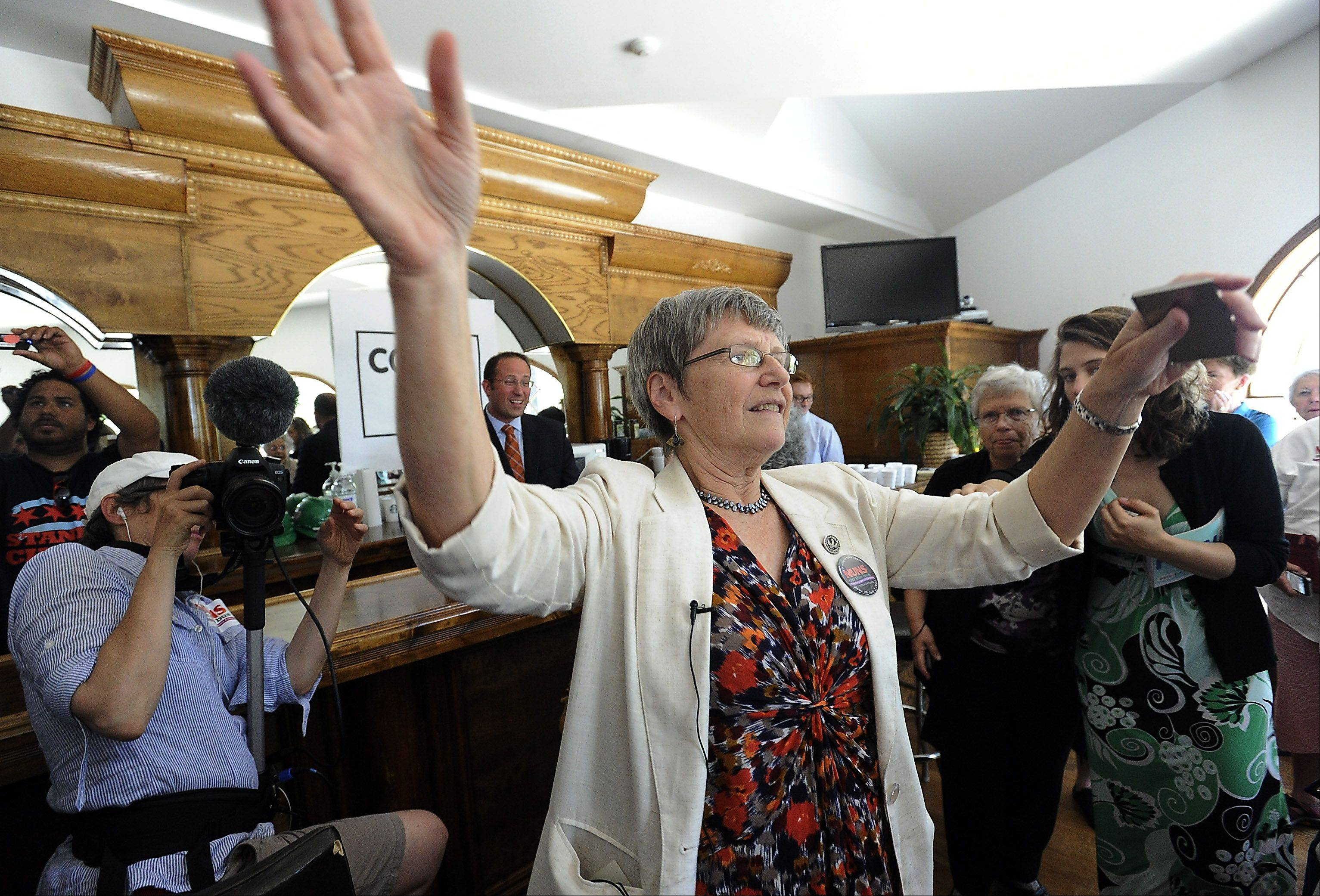 Sister Simone Campbell, of the Nuns on the Bus tour, gathers the crowd that joined her in Congressman Joe Walsh headquarters in Fox Lake on Wednesday.