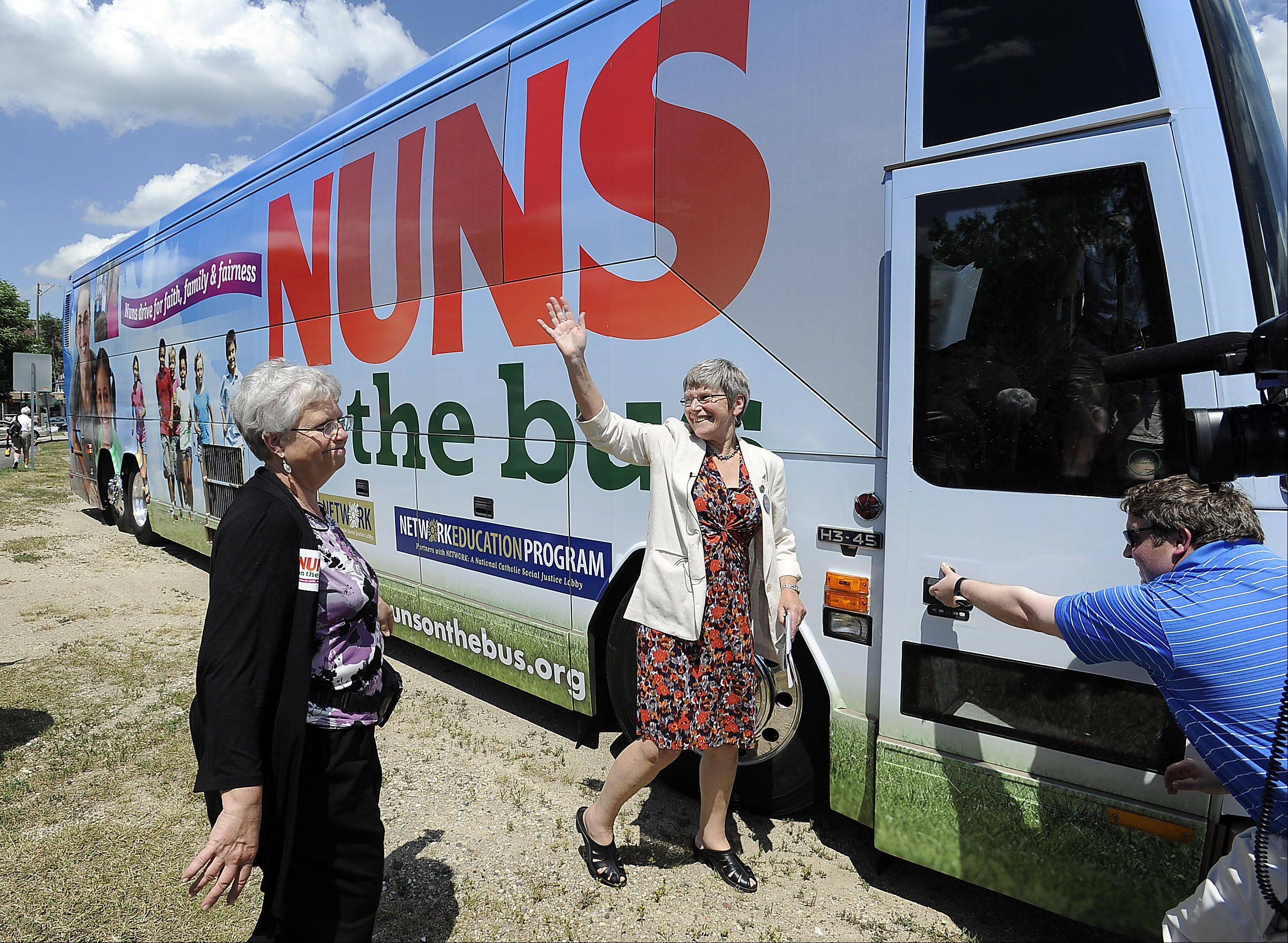 Sister Simone Campbell, of the Nuns on the Bus tour, waves goodbye to the crowd that joined her in Congressman Joe Walsh headquarters in Fox Lake on Wednesday.
