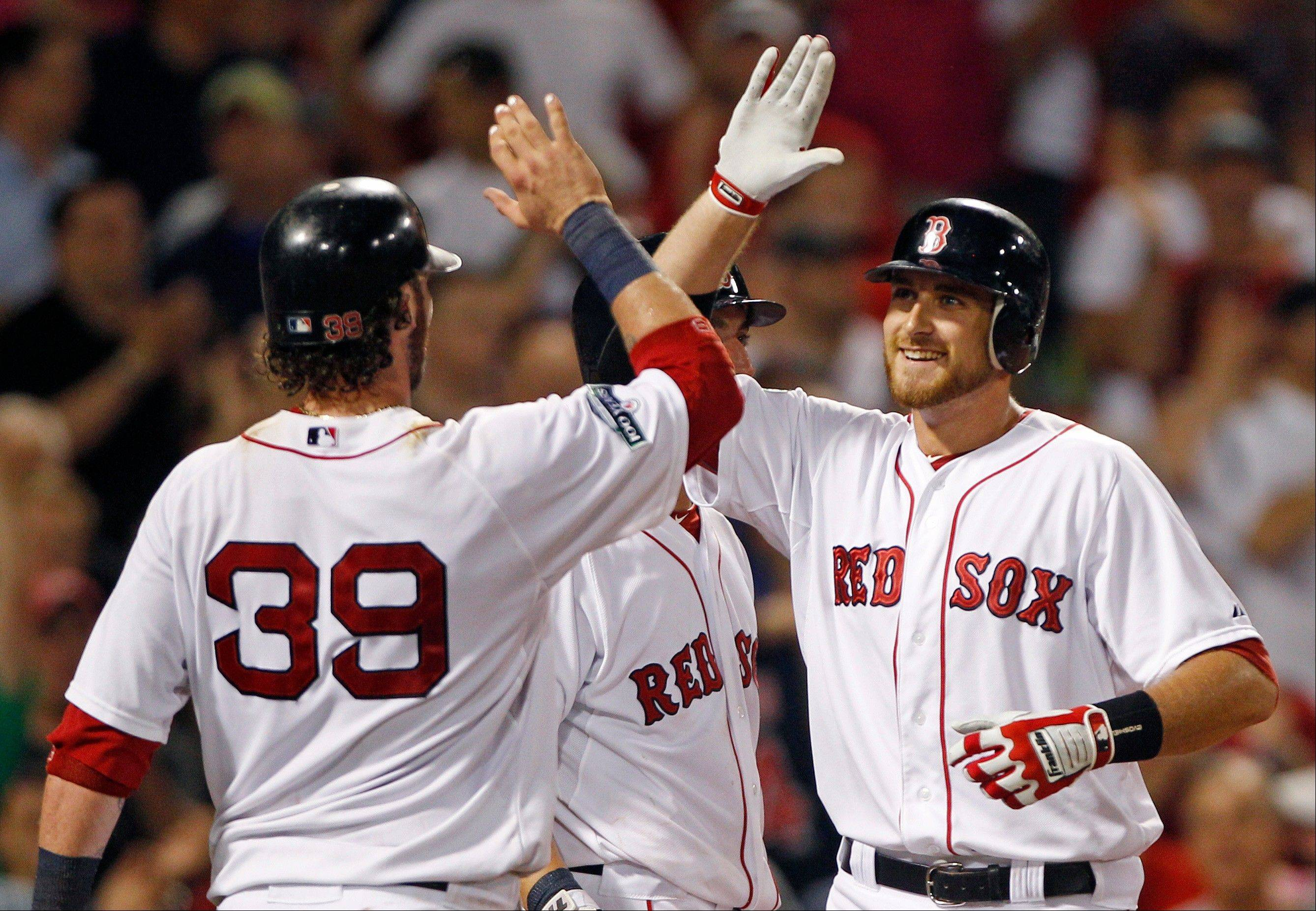 Boston Red Sox third baseman Will Middlebrooks, right, is congratulated by Jarrod Saltalamacchia (39) after his two-run home run against the Miami Marlins Thursday during the eighth inning at Fenway Park in Boston.
