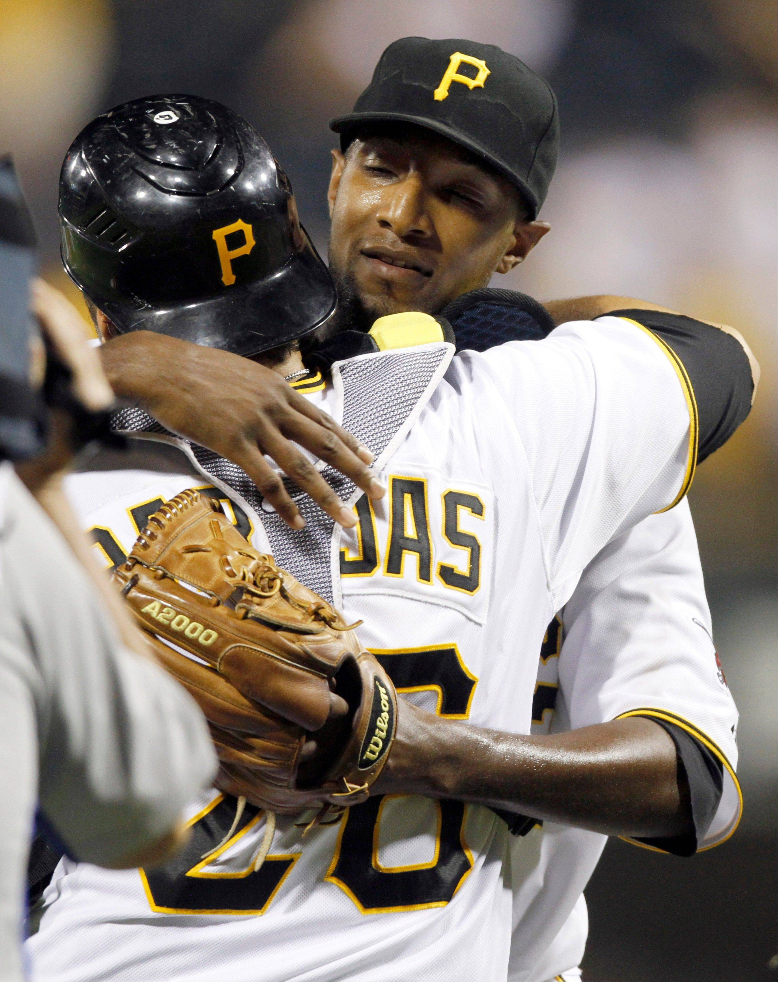 Pittsburgh Pirates starter James McDonald, right, hugs catcher Rod Barajas after pitching a complete game and defeating the Minnesota Twins 9-1.