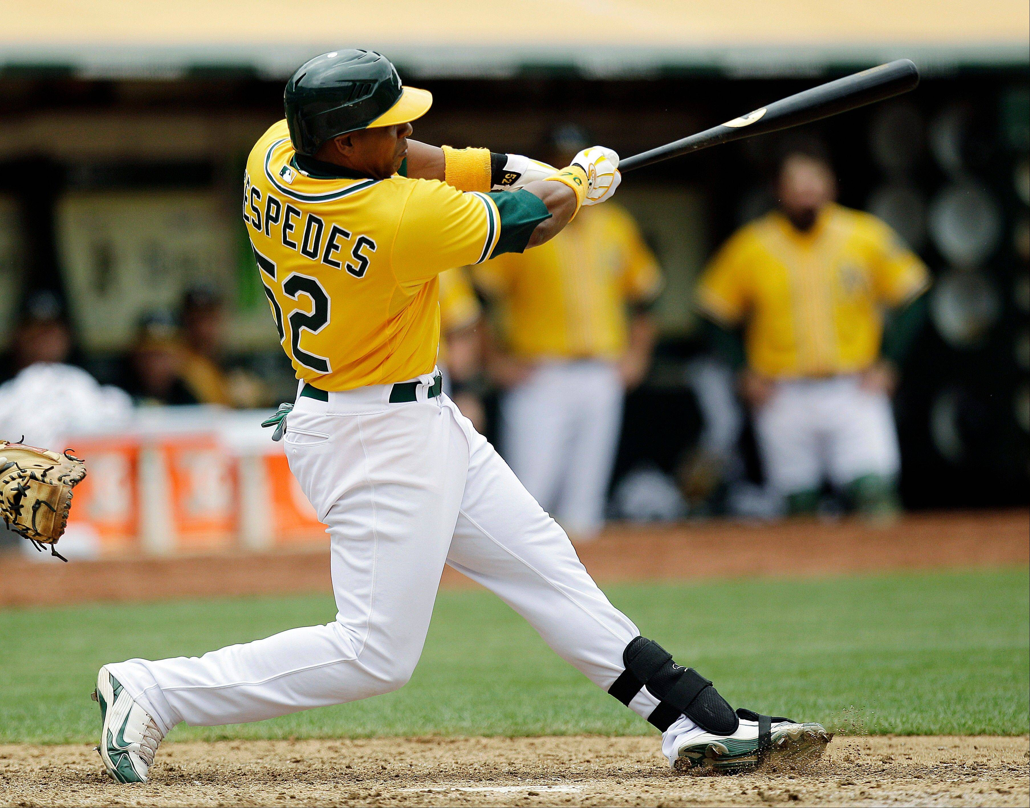 The Oakland Athletics' Yoenis Cespedes hits a walk-off, three-run home run off Los Angeles Dodgers pitcher Josh Lindblom Thursday during the ninth inning in Oakland, Calif. The Athletics won 4-1.