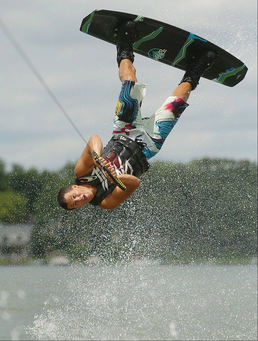 Pierce Homsey of Mundelein performs some wakeboarding tricks at the Mundelein Park and Recreation District's Diamond Lake Wakeboard Competition and Demo.