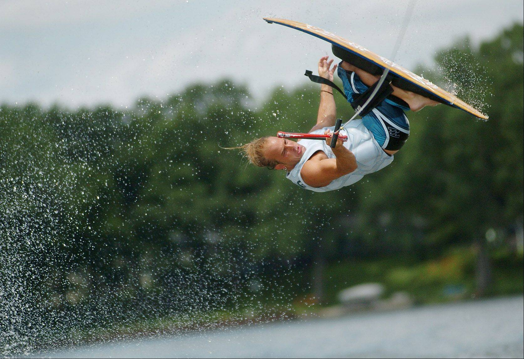 Frankie Panno of Streamwood performs a kneeboarding jump at the Mundelein Park and Recreation District's Diamond Lake Wakeboard Competition and Demo.