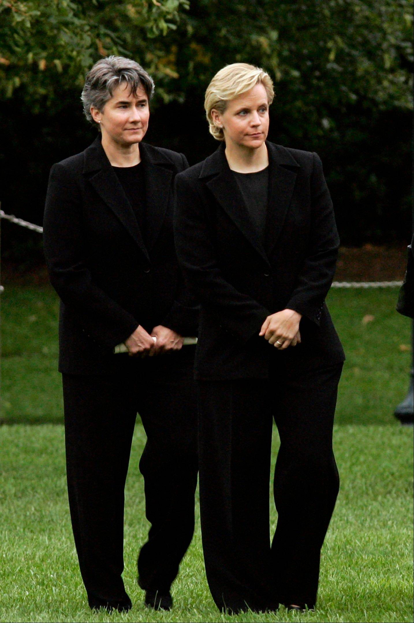 Associated Press/Sept. 11, 2006 Mary Cheney, right, the openly gay daughter of then-Vice President Dick Cheney, stands with Heather Poe, left, during a memorial observance on the South Lawn of the White House in Washington. Cheney married her longtime partner, Poe, on Friday.