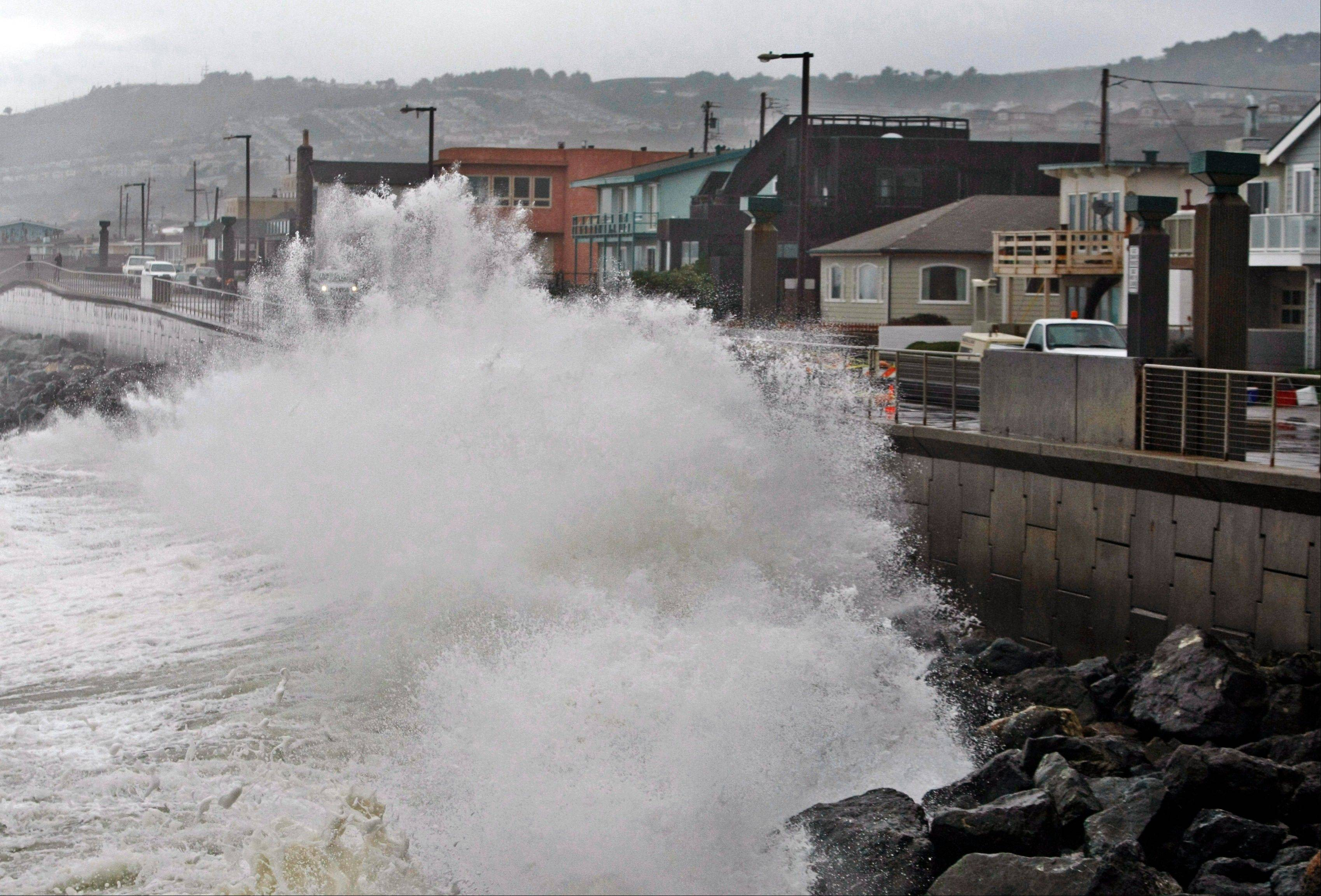 Associated Press/Jan. 20, 2010 Waves pound a wall near buildings in Pacifica, Calif., during a rain storm. A new federal report gives the West Coast its best look yet at what to expect from rising sea levels.