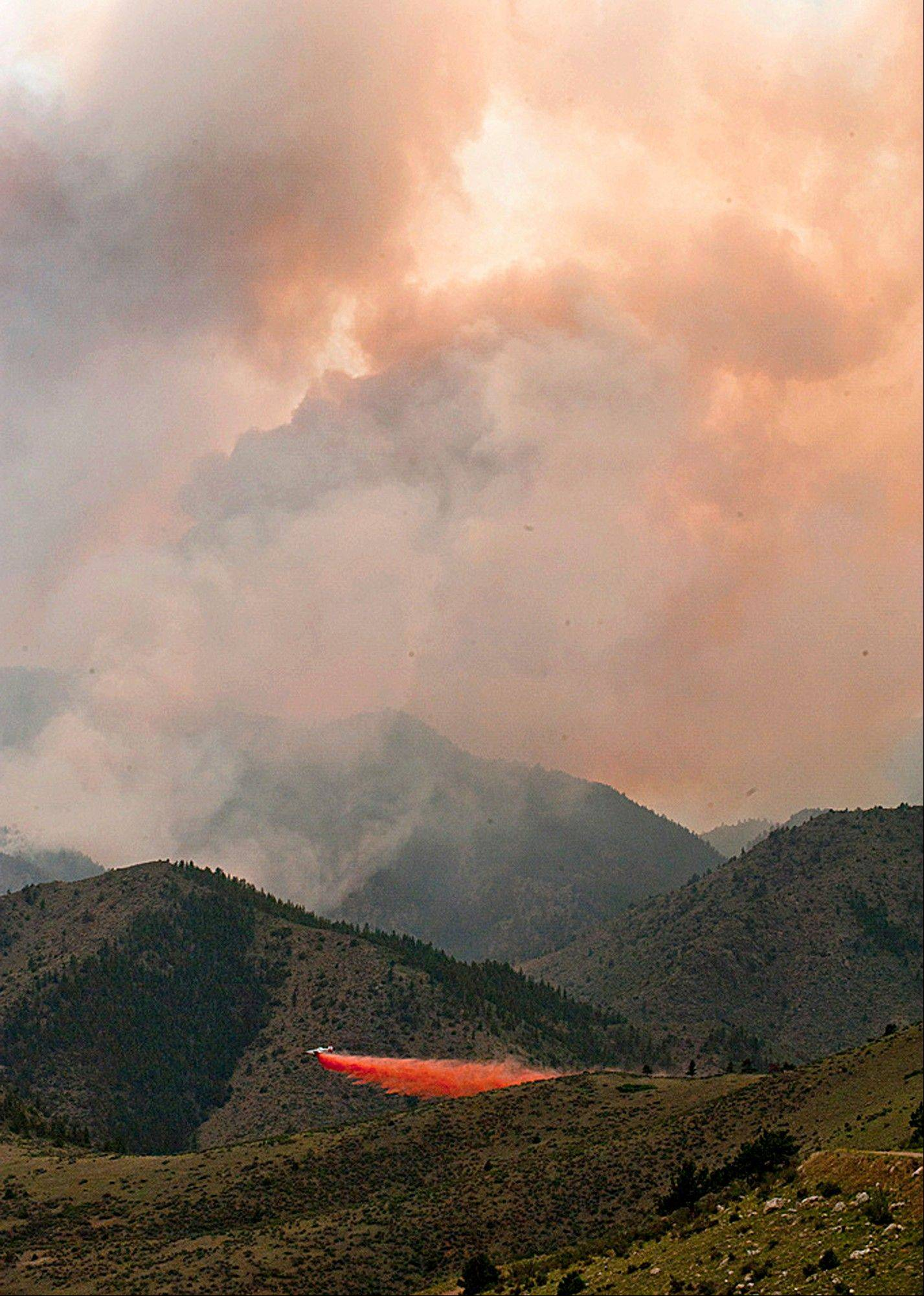Associated Press/June 19, 2012 An aircraft drops a load of fire retardant slurry above the High Park wildfire about 15 miles west of Fort Collins, Colo. The ammonium phosphate dropped from airplanes to slow the spread of raging wildfires can turn a pristine mountain stream into a death zone for trout.