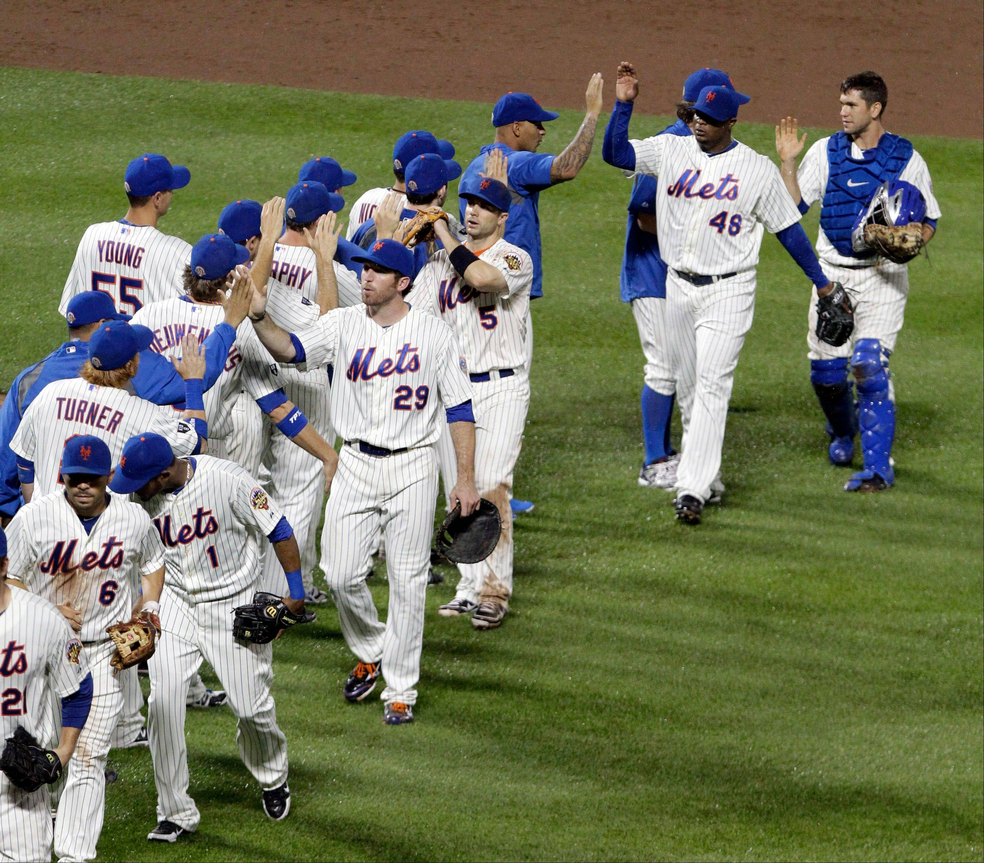 Frank Francisco (48), David Wright (5) and Ike Davis (29) celebrate with teammates Friday after a win at home against the Yankees.