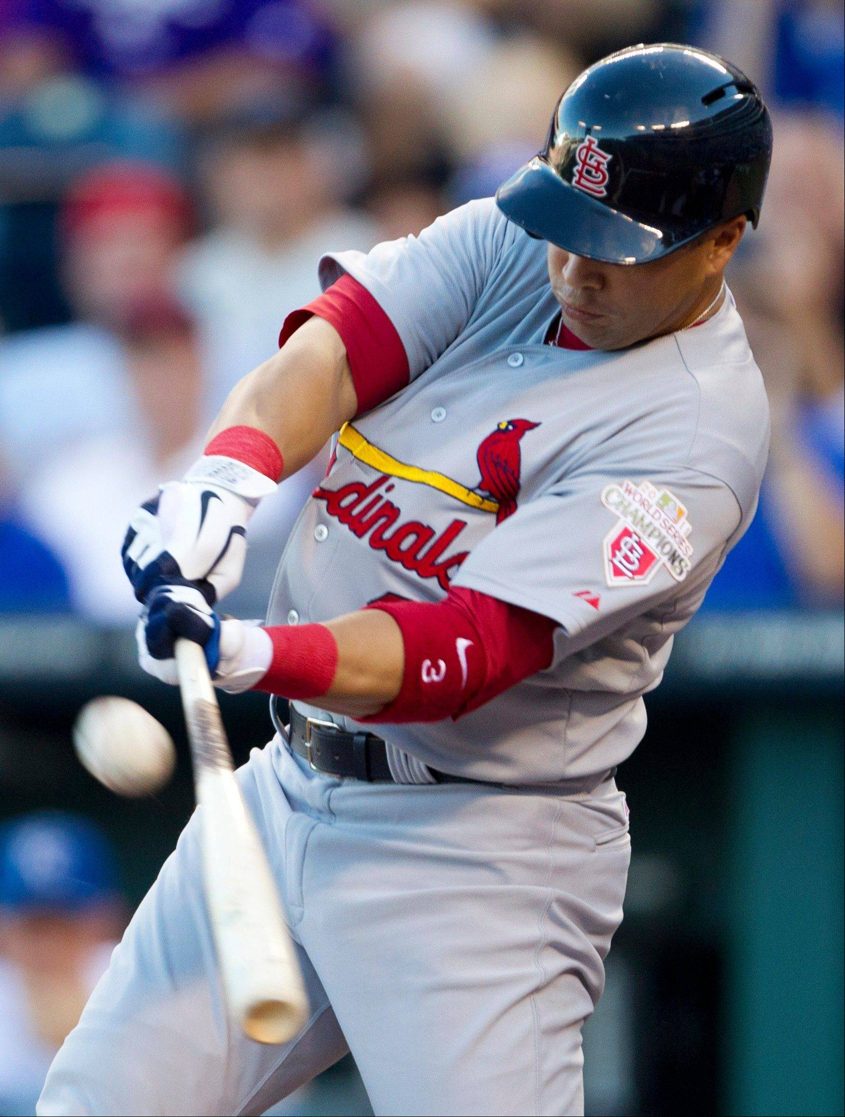 The Cardinals' Carlos Beltran hits a two-run double off Royals pitcher Vin Mazzaro during the first inning Friday in Kansas City, Mo.