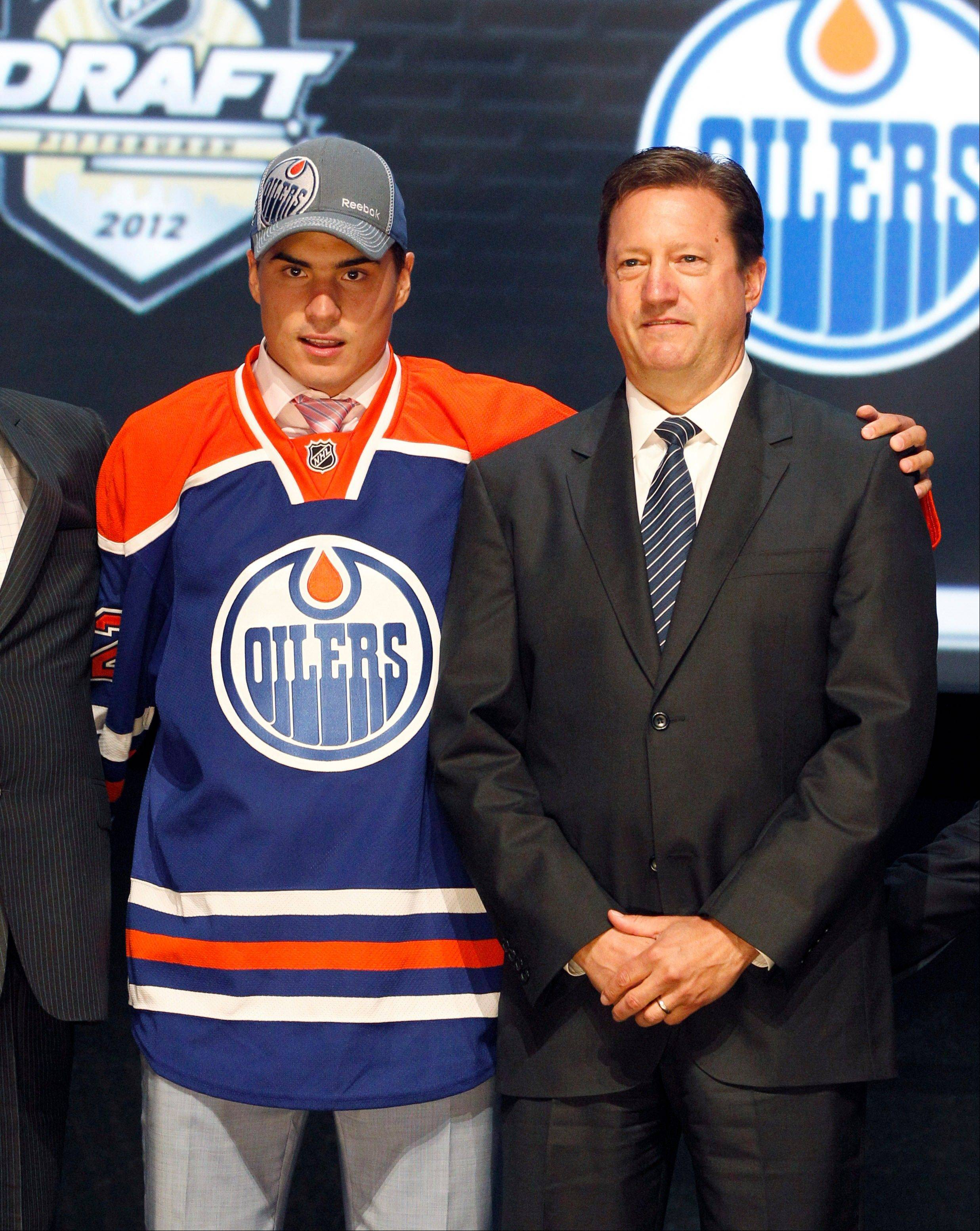 Nail Yakupov, left, a winger from Russia who was chosen first overall by the Edmonton Oilers in the first round of the NHL hockey draft, stands with Oilers general manager Steve Tambellini on Friday in Pittsburgh.