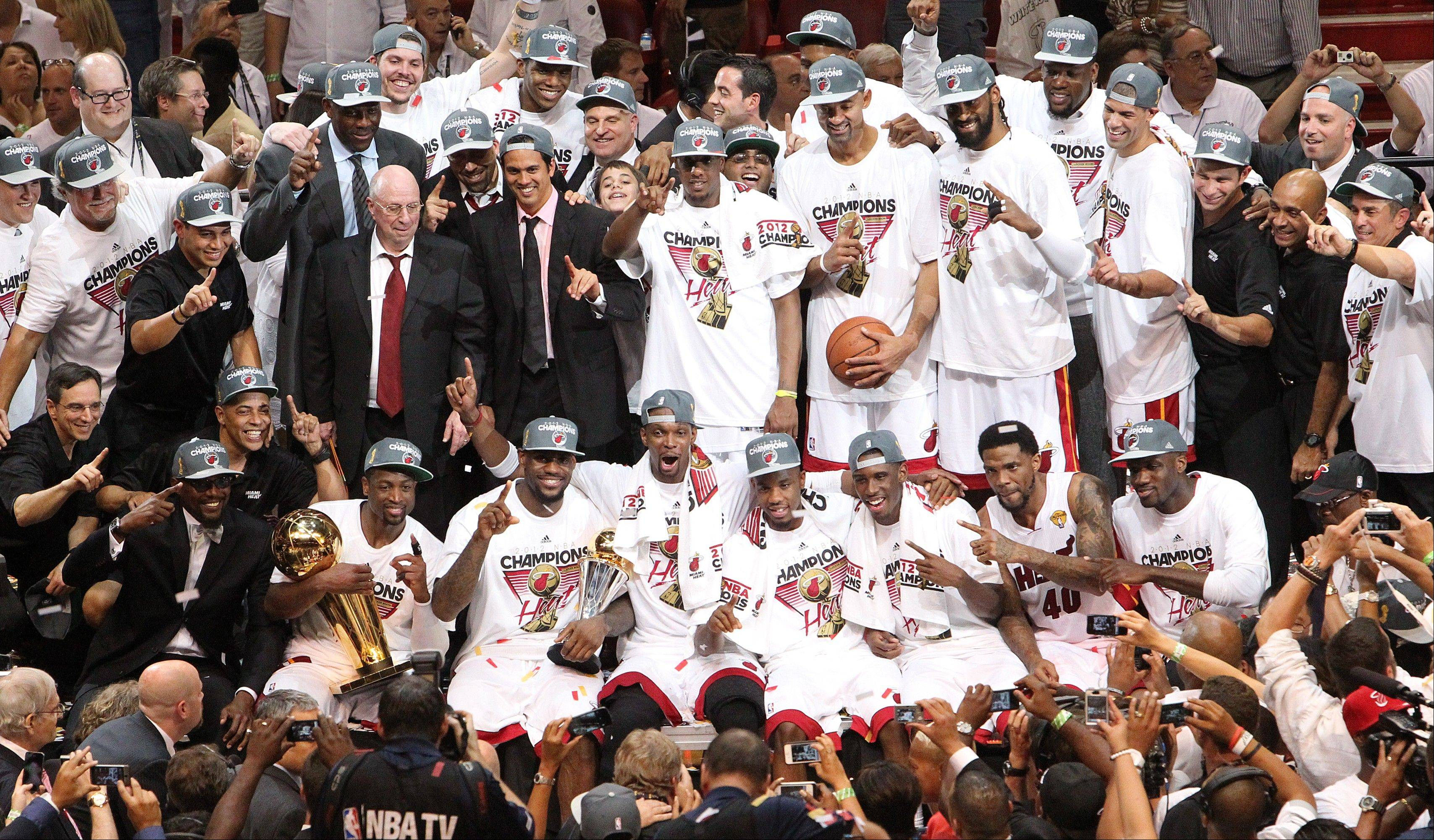 The Miami Heat celebrate Thursday after they defeated the Oklahoma City Thunder in game 5 of the NBA Finals at the American Airlines Arena in Miami.