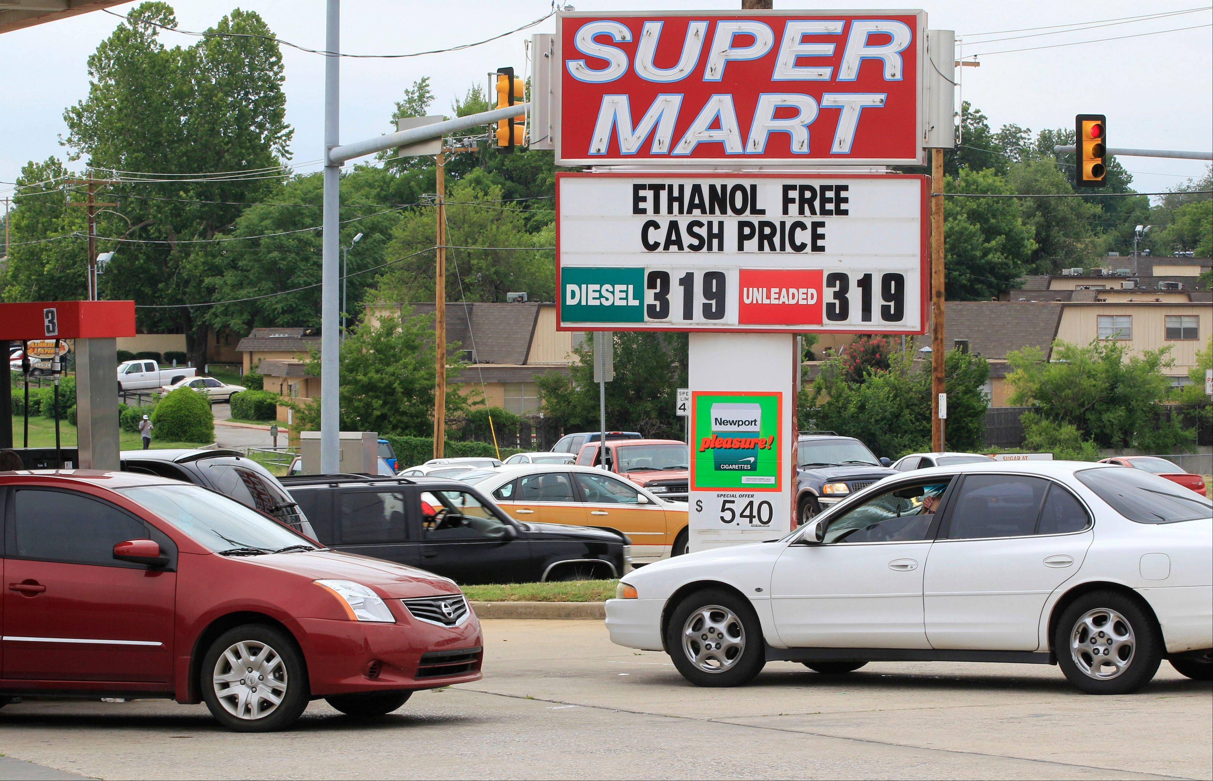 Cars line up for gasoline at an advertised cash price of $3.19 at Super Mart in Oklahoma City, Thursday.