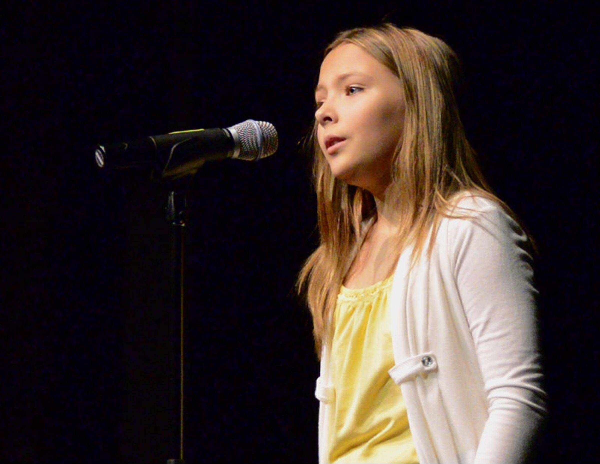 Agne Giedraityte, 10, of Downers Grove competes in Suburban Chicago's Got Talent auditions at the Metropolis Performing Arts Centre in Arlington Heights. Agne is one of 11 singers featured in the top 20 finalists for the competition.