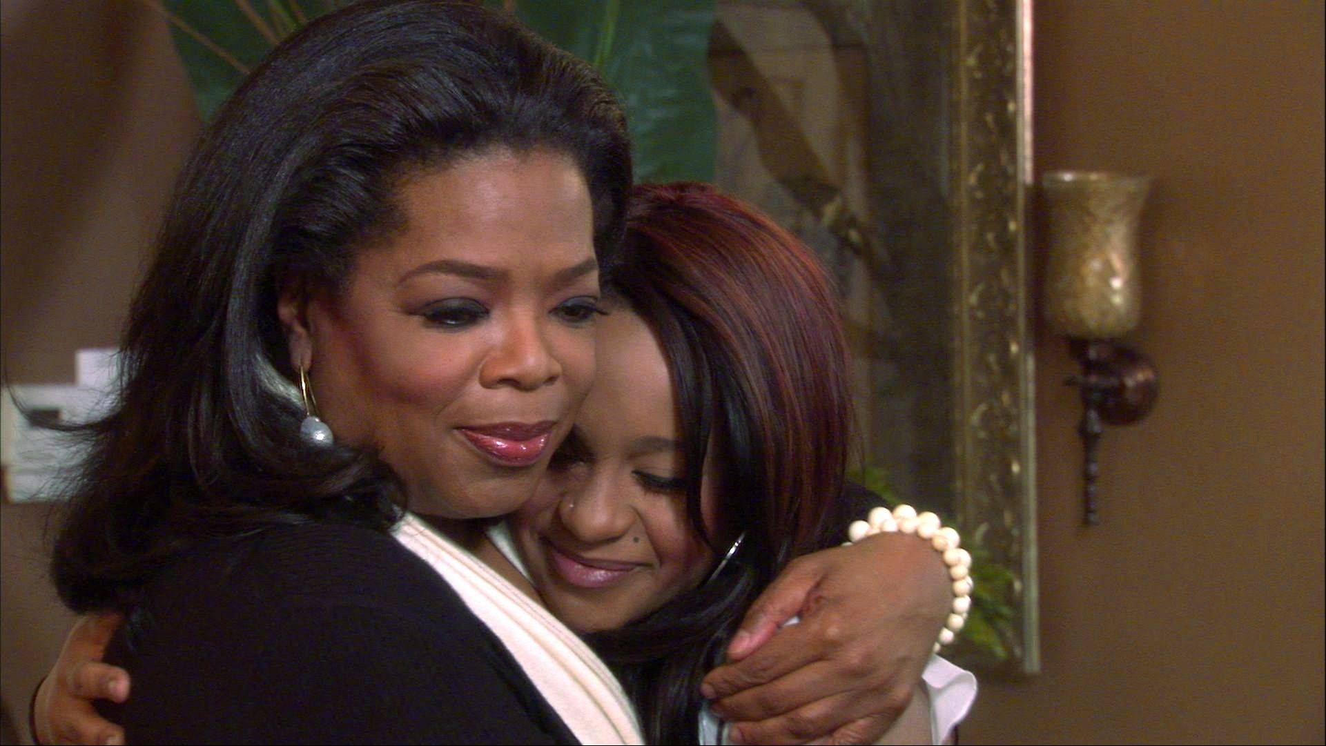 Host Oprah Winfrey embraces Bobbi Kristina, daughter of the late singer Whitney Houston during an interview in Atlanta, Ga.
