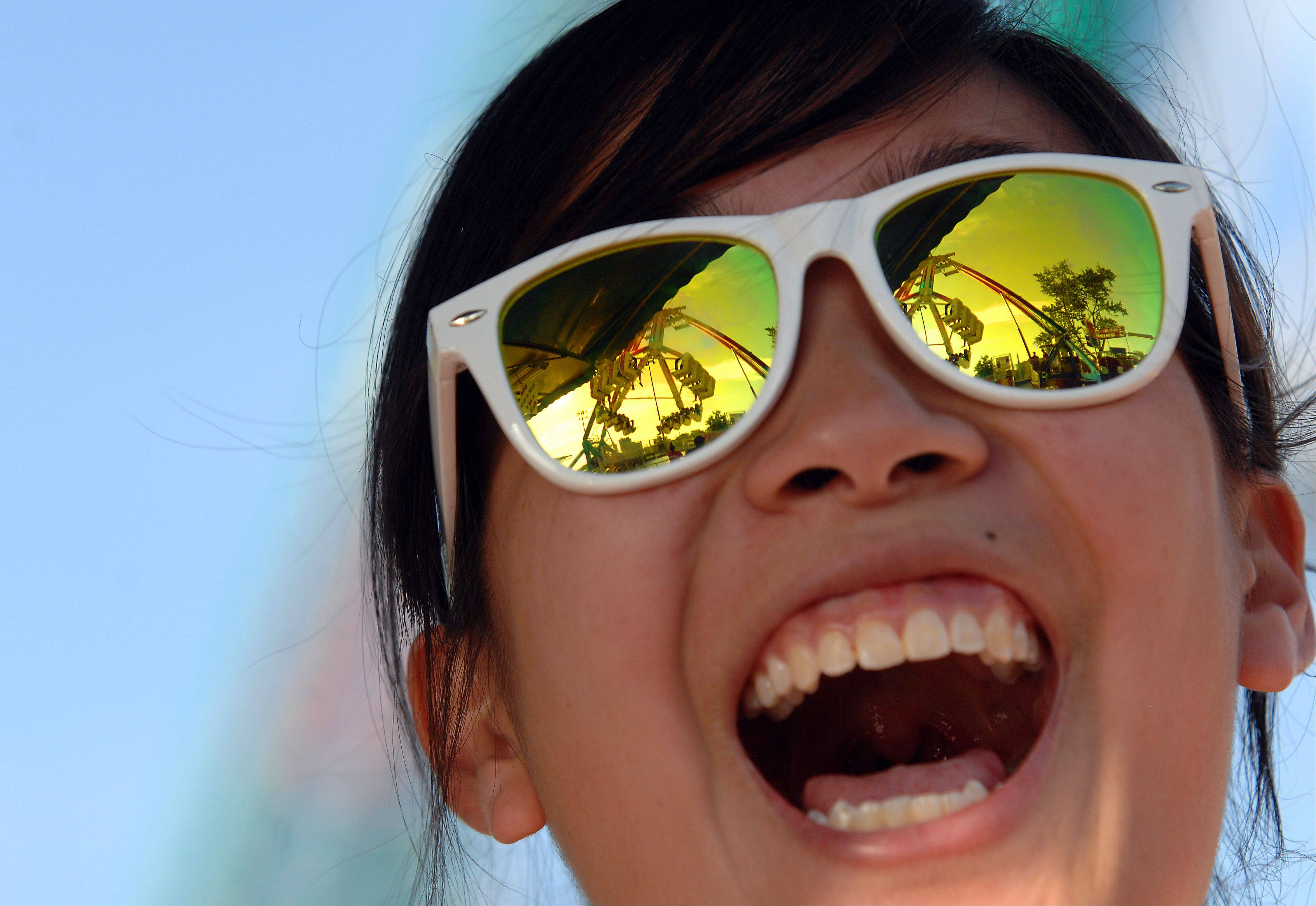 Liz Chan, 19, of Des Plaines screams with delight as she watches her boyfriend ride the Freak Out at Elk Grove's Rotaryfest on Friday.