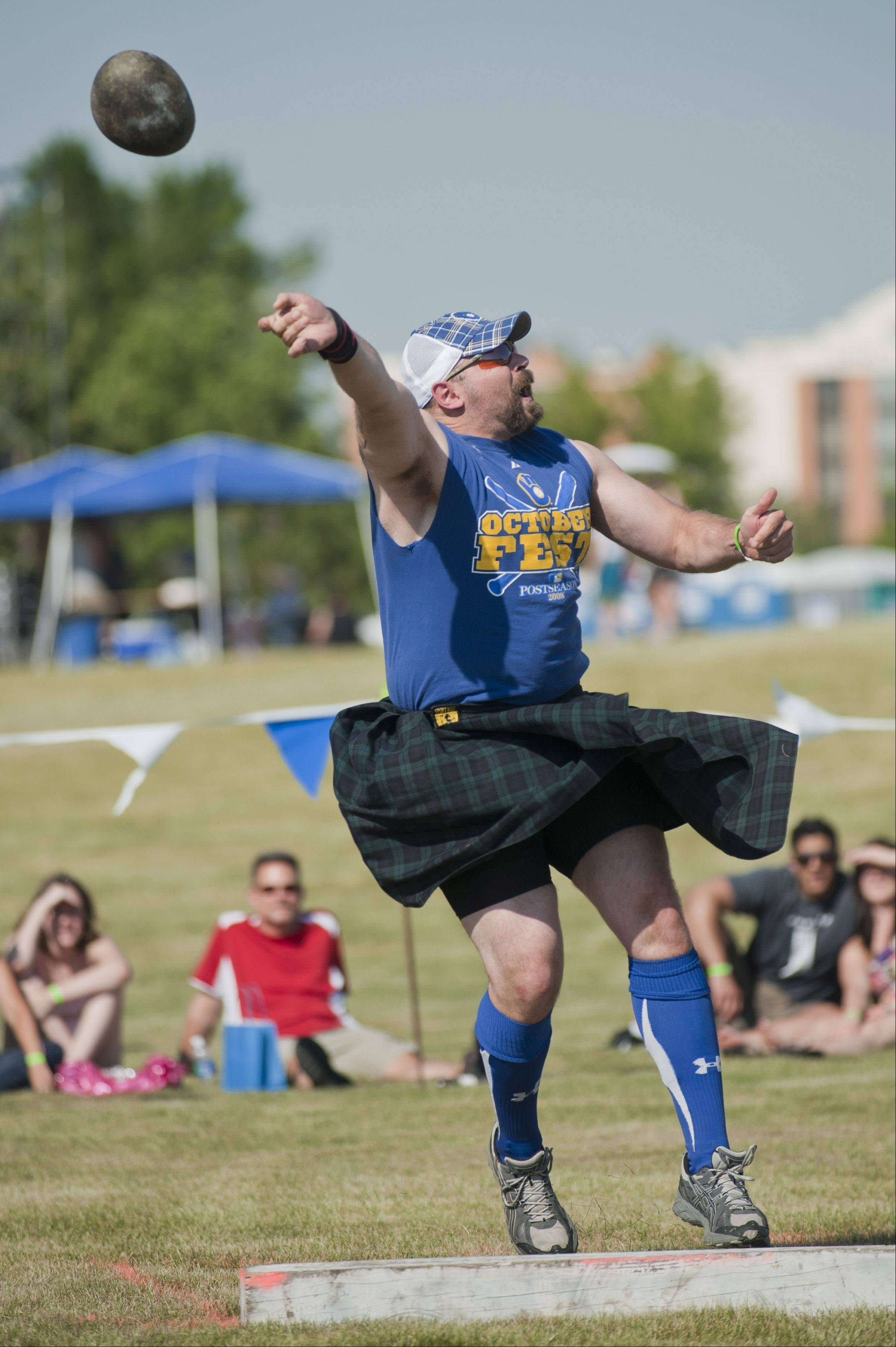 Luke Hilgers from Stevens Point Wisconsin, heaves a 28 pound stone during the heavyweight athletic exhibition at the annual Illinois St. Andrew Society Scottish Festival and Highland Games in Itasca on Friday.