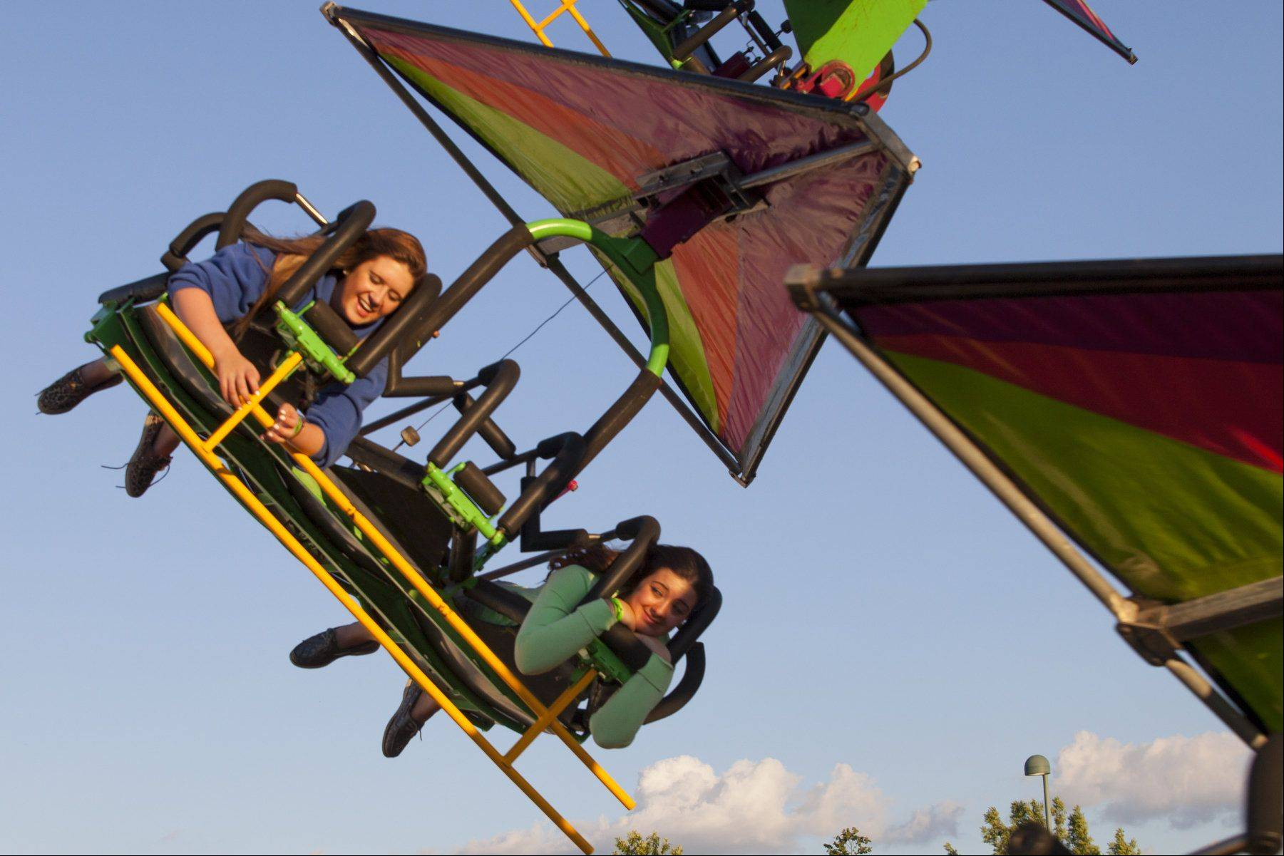 (from left) Alex Schneidei (15) of Woodfield and Alexa Montefusco (15) of Naperville ride gliders at Carol Stream's Summer Carnival, which is held from June 21-24 at the Ross Ferraro Town Center. On Saturday the carnival is free for children with special needs and their families from noon to 2 p.m.