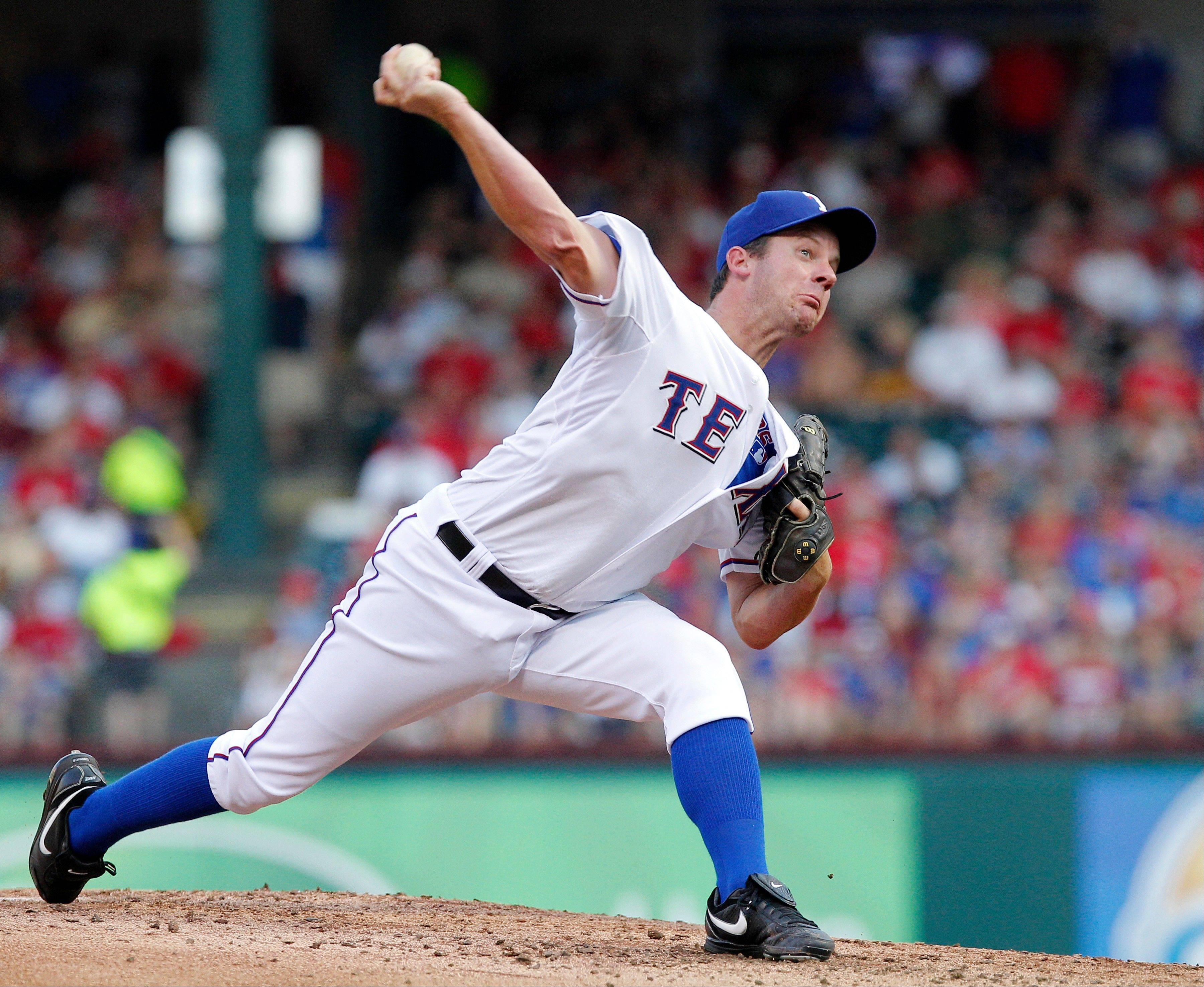 Rangers pitcher Roy Oswalt throws against the Colorado Rockies during the second inning Friday in Arlington, Texas.
