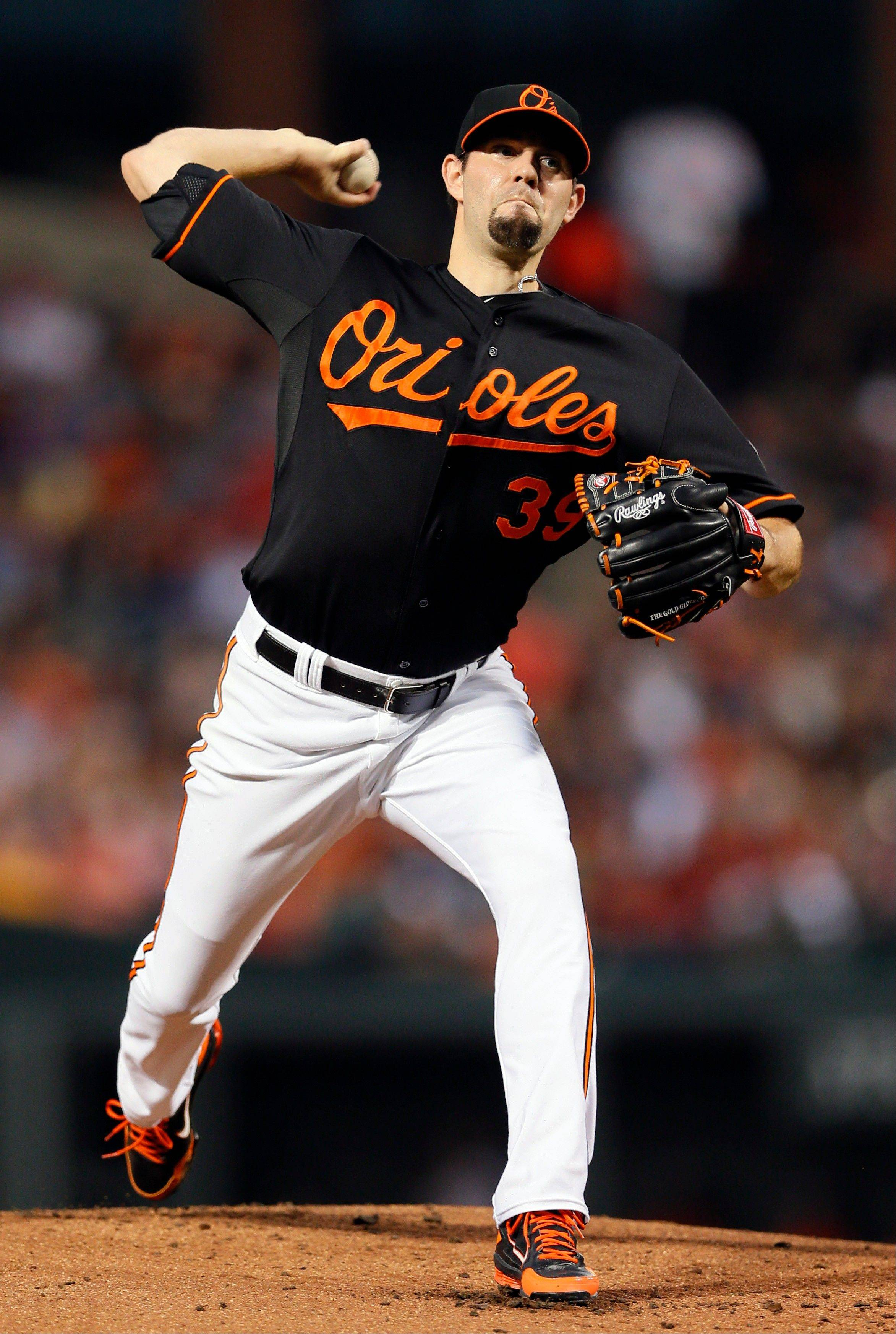 Baltimore Orioles starting pitcher Jason Hammel throws to the Washington Nationals Friday during the first inning in Baltimore.