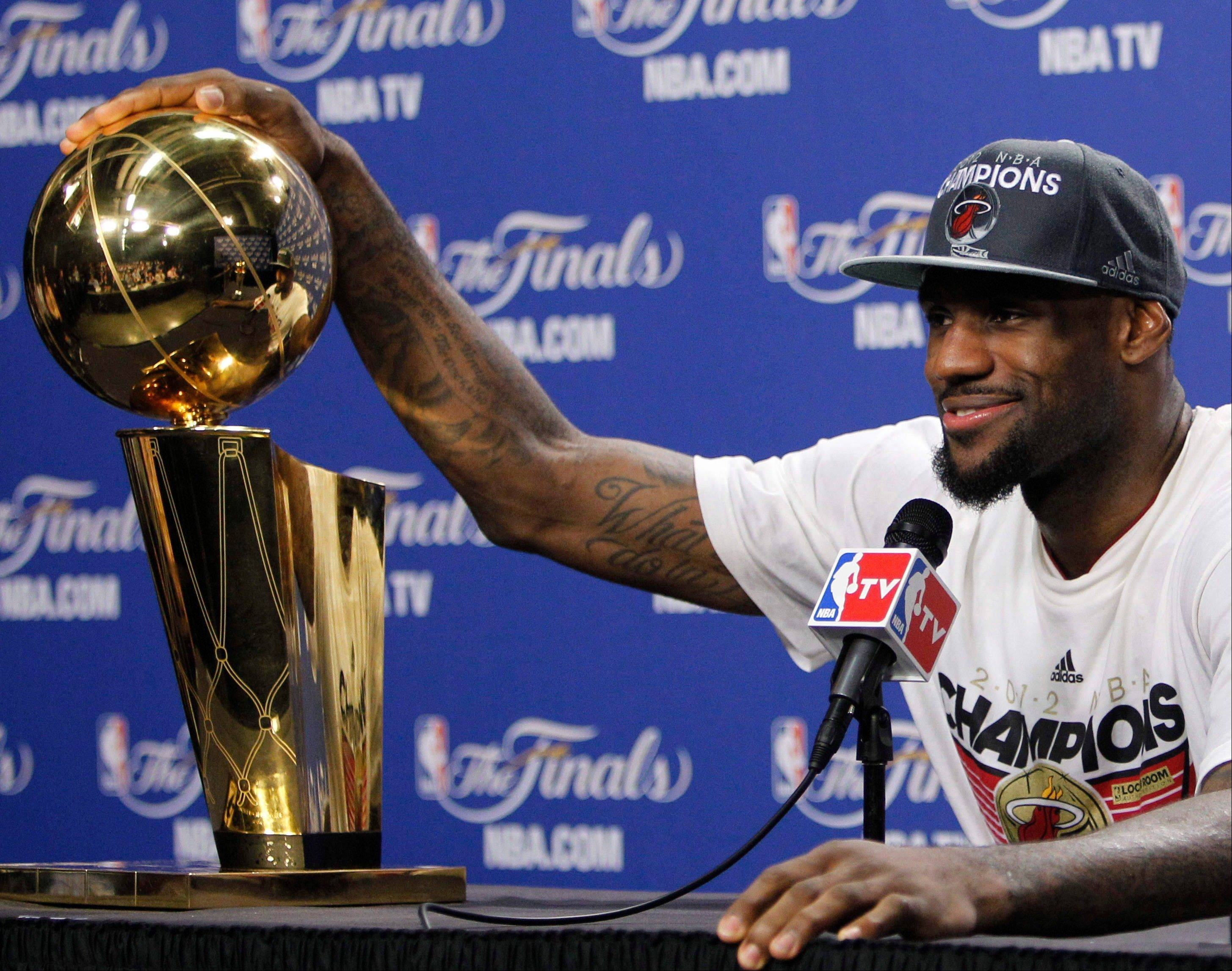 Miami's LeBron James now has an NBA Championship Trophy to go with his MVP hardware. Daily Herald NBA writer Mike McGraw says time, not another title, will help change LeBron's images as a player some fans love to hate.