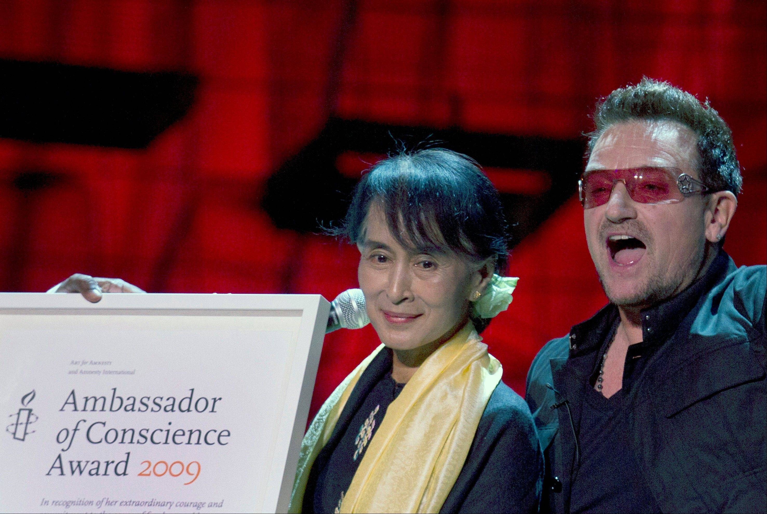 Irish singer Bono hands Myanmar opposition leader Aung San Suu Kyi the Amnesty International's Ambassador of Conscience award in Dublin, Ireland, Monday, June 18, 2012. The award was made in 2009, and this is the first opportunity for Kyi to get the award due to her house arrest in Myanmar.