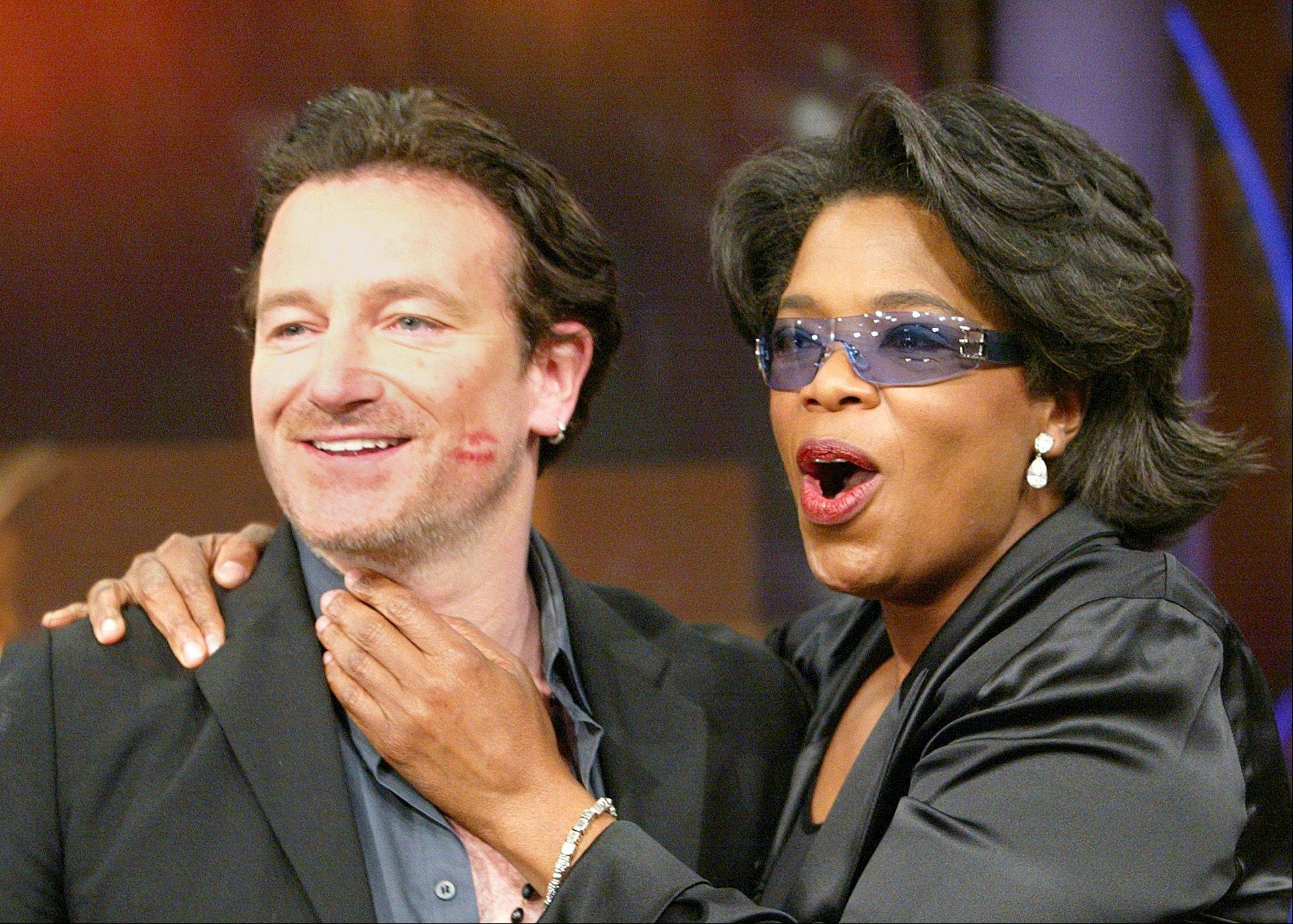 "Irish rock star Bono, left, sports lipstick from talk show host Oprah Winfrey during taping of ""The Oprah Winfrey Show"" Tuesday, Sept. 17, 2002, in Chicago. The two talked about their mutual concerns about issues confronting Africa. Earlier this year Bono took a 10-day tour of sub-Saharan Africa. The show is scheduled to air Friday."